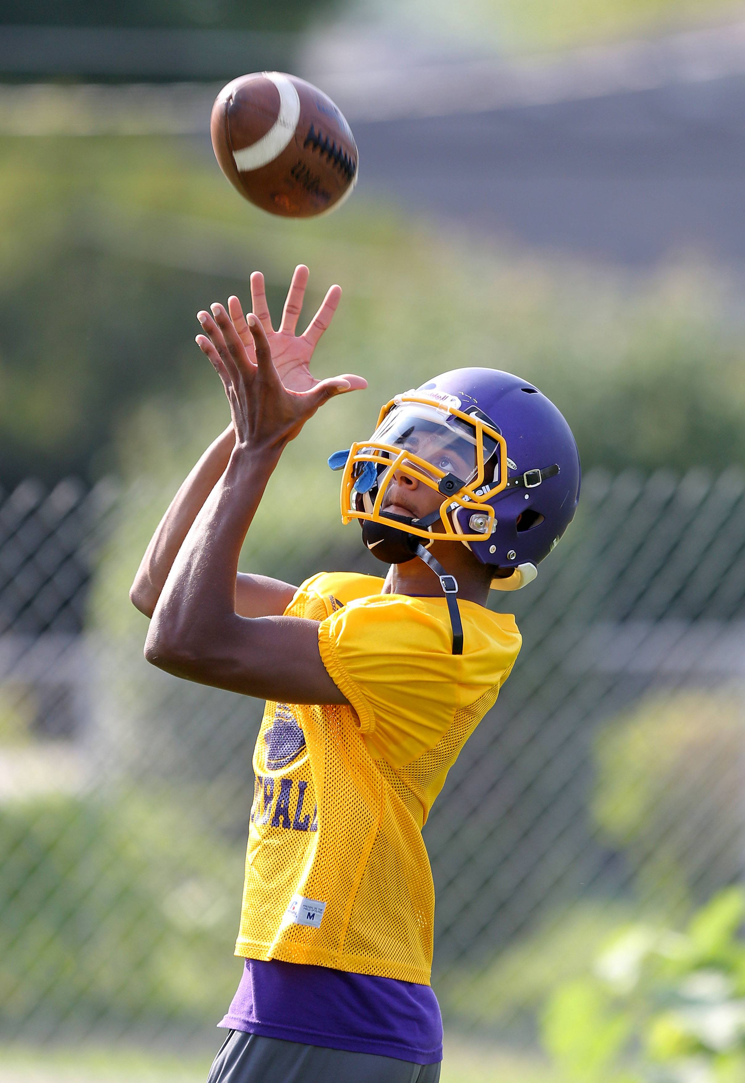 Receiver Josh Anderson makes a catch during football practice Monday at Wauconda.