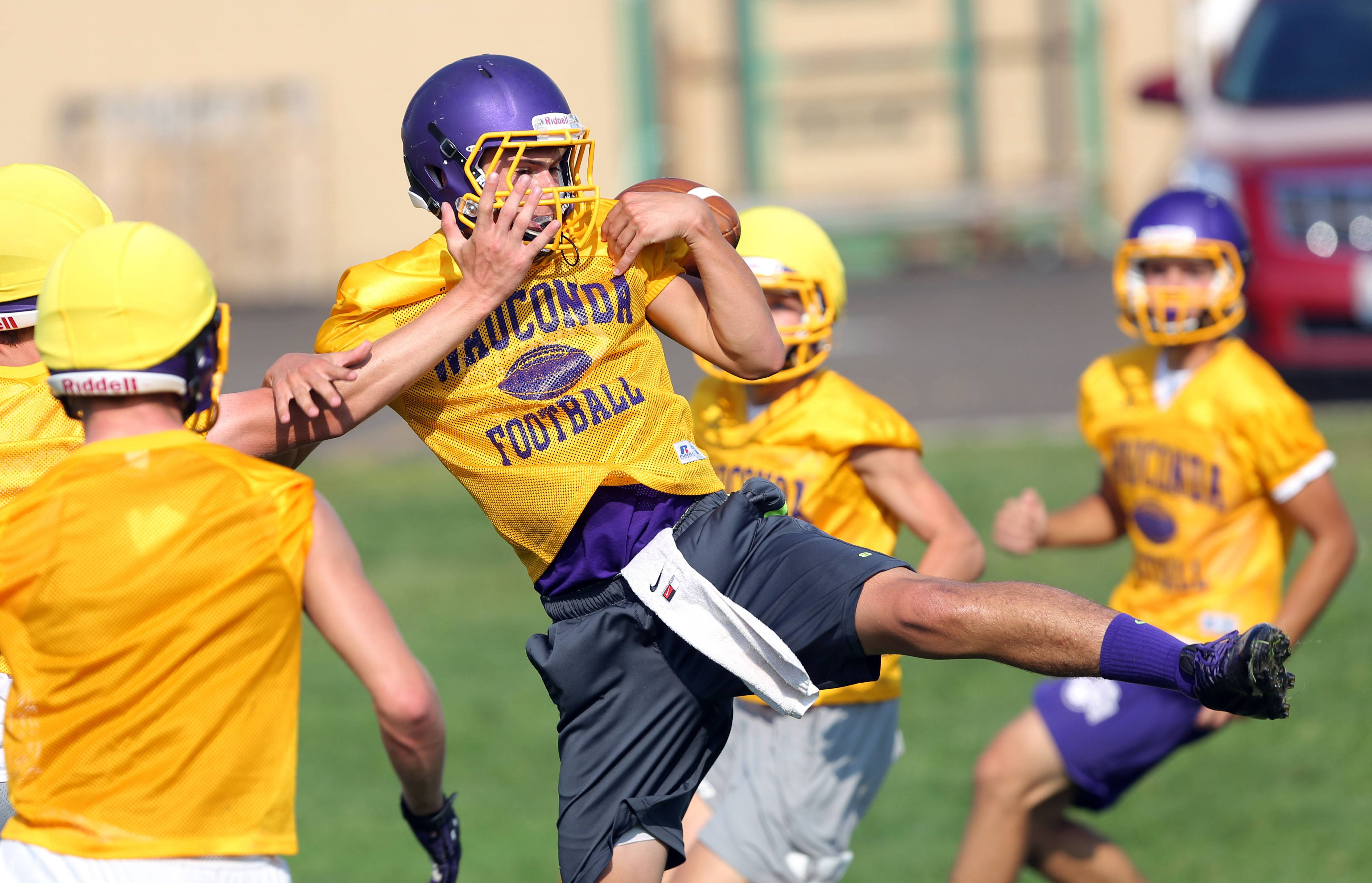 Receiver Jake Grobenly makes a catch during football practice Monday at Wauconda.