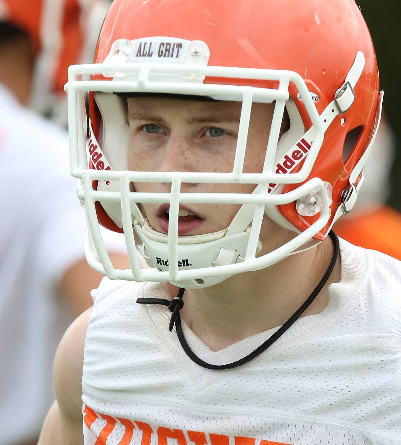 Wide receiver Cole Monckton wears a leather cord around his neck as a sign of unity with the team during the first day of football practice at Hersey High School on Monday.