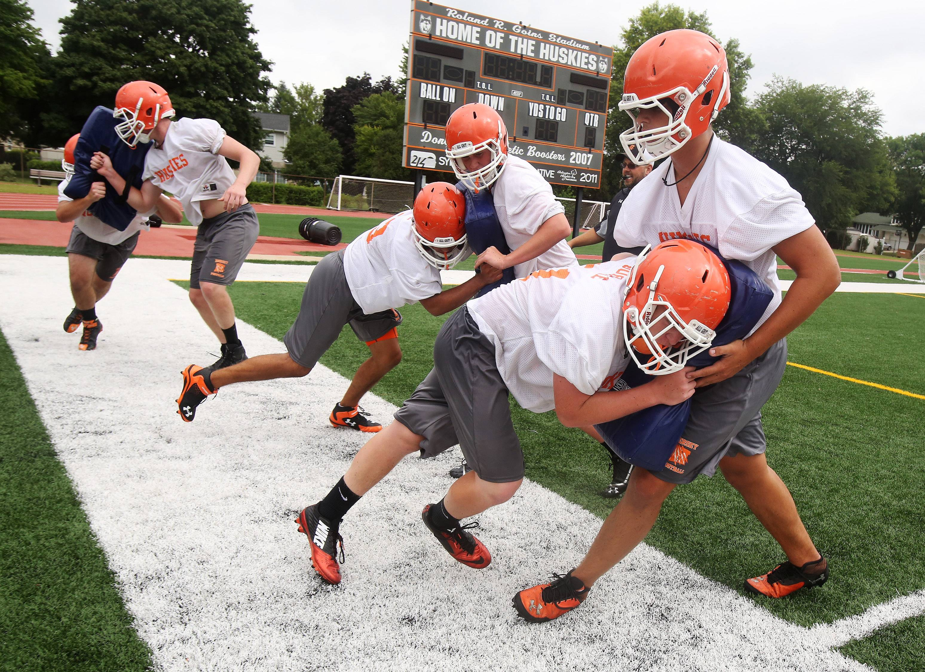 Linemen go through blocking drills during the first day of football practice at Hersey High School on Monday.