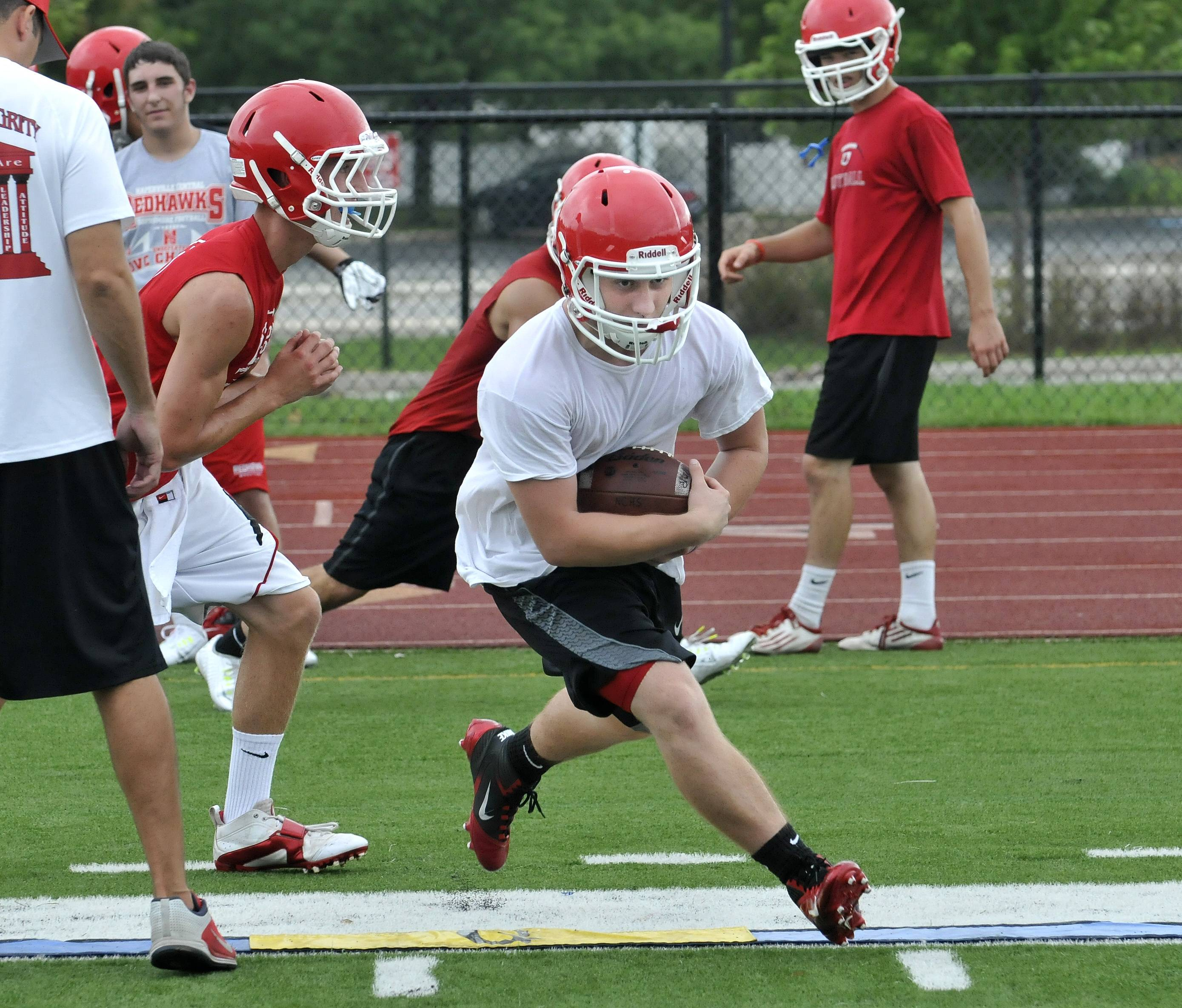 Naperville Central High School's offensive backs work on inside runs.