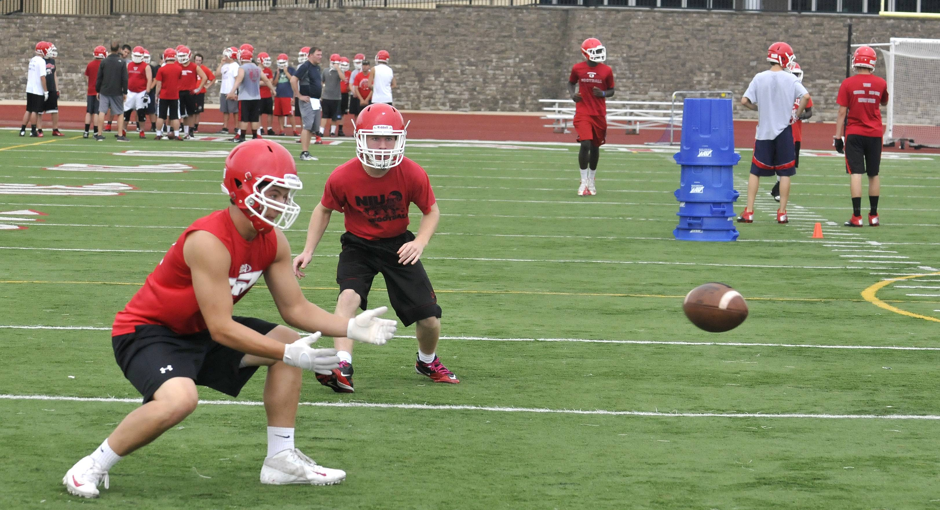Naperville Central High School's special team members practice catching kickoffs.