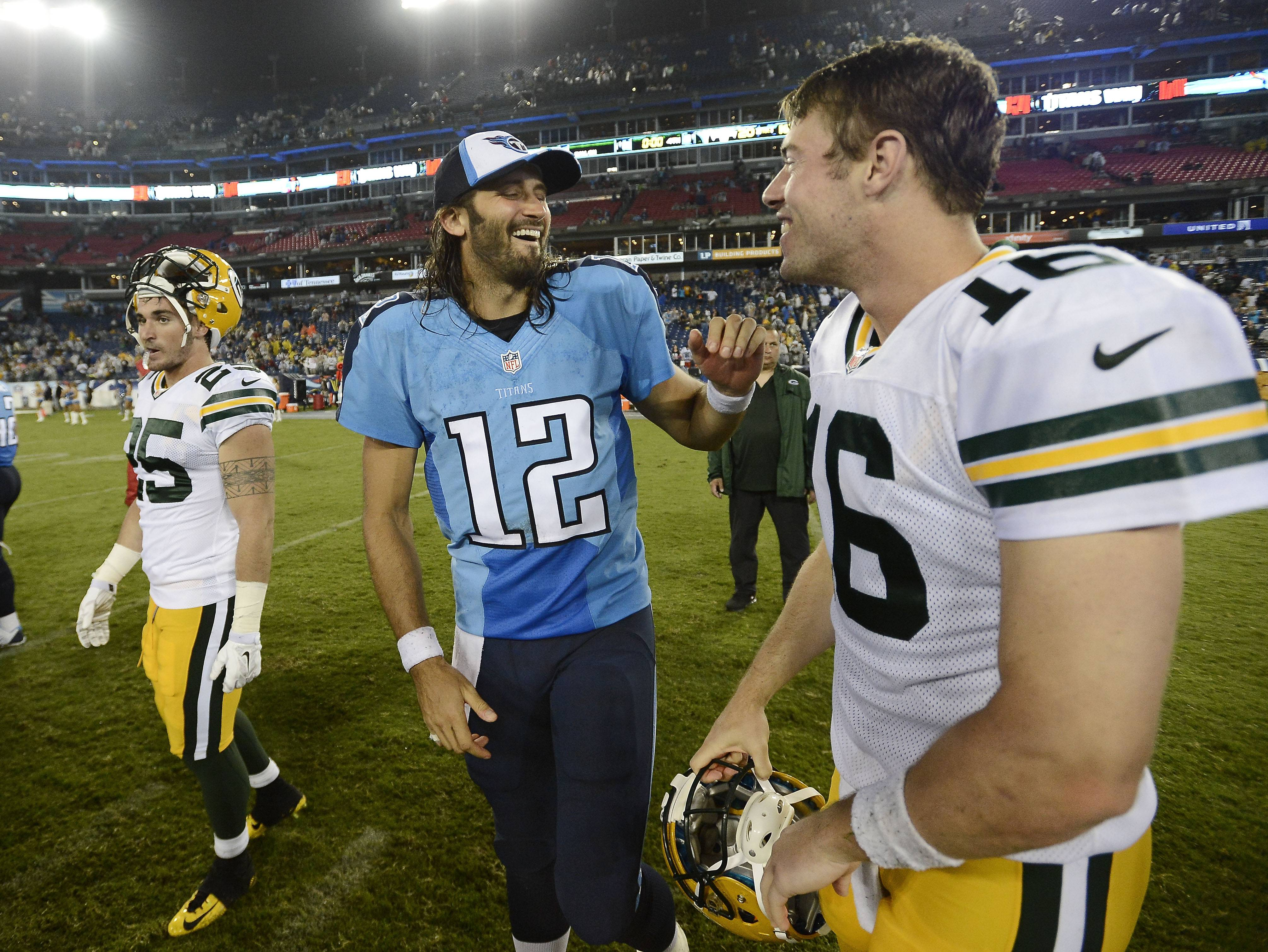 Tennessee Titans quarterback Charlie Whitehurst (12) talks with Green Bay Packers quarterback Scott Tolzien (16) after the Titans defeated the Packers last Saturday. The Packers will play at St. Louis on Saturday.