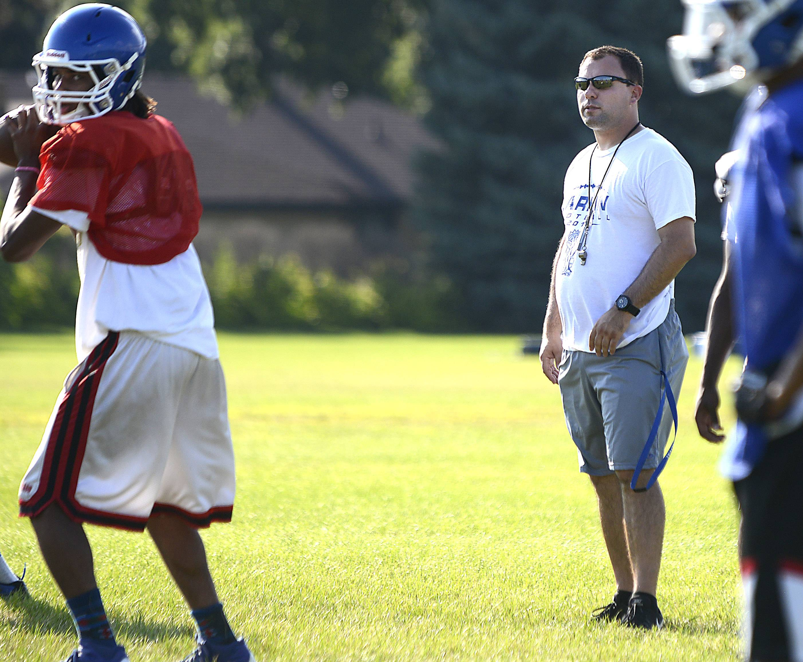 New head football coach Dragon Teonic at a Larkin practice.
