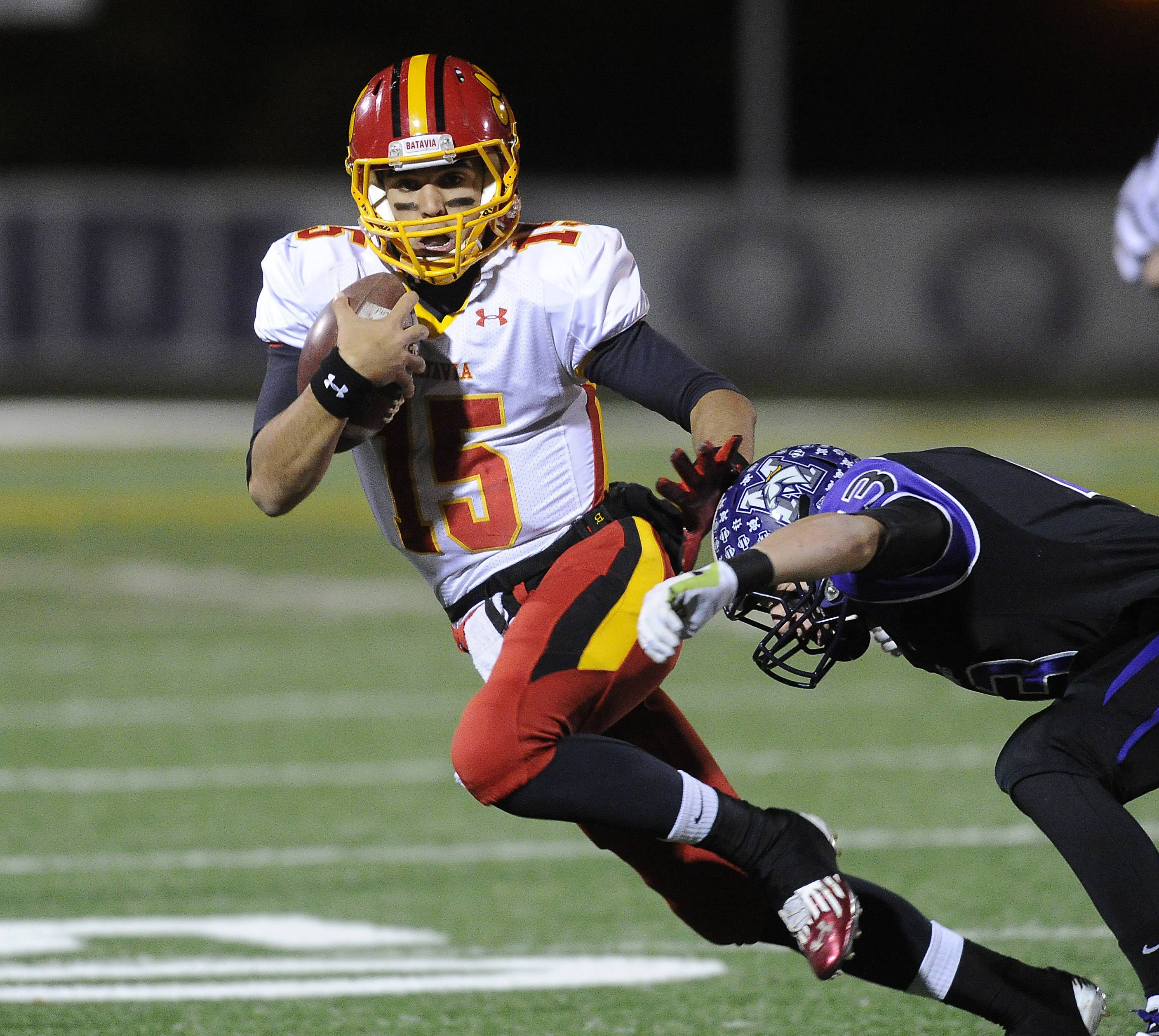 Rolling Meadows' Peyton Dezonna lays out to bring down Batavia quarterback Micah Coffey last season in Class 6A playoff action. Dezonna is one of two returning defensive starters for the Mustangs.