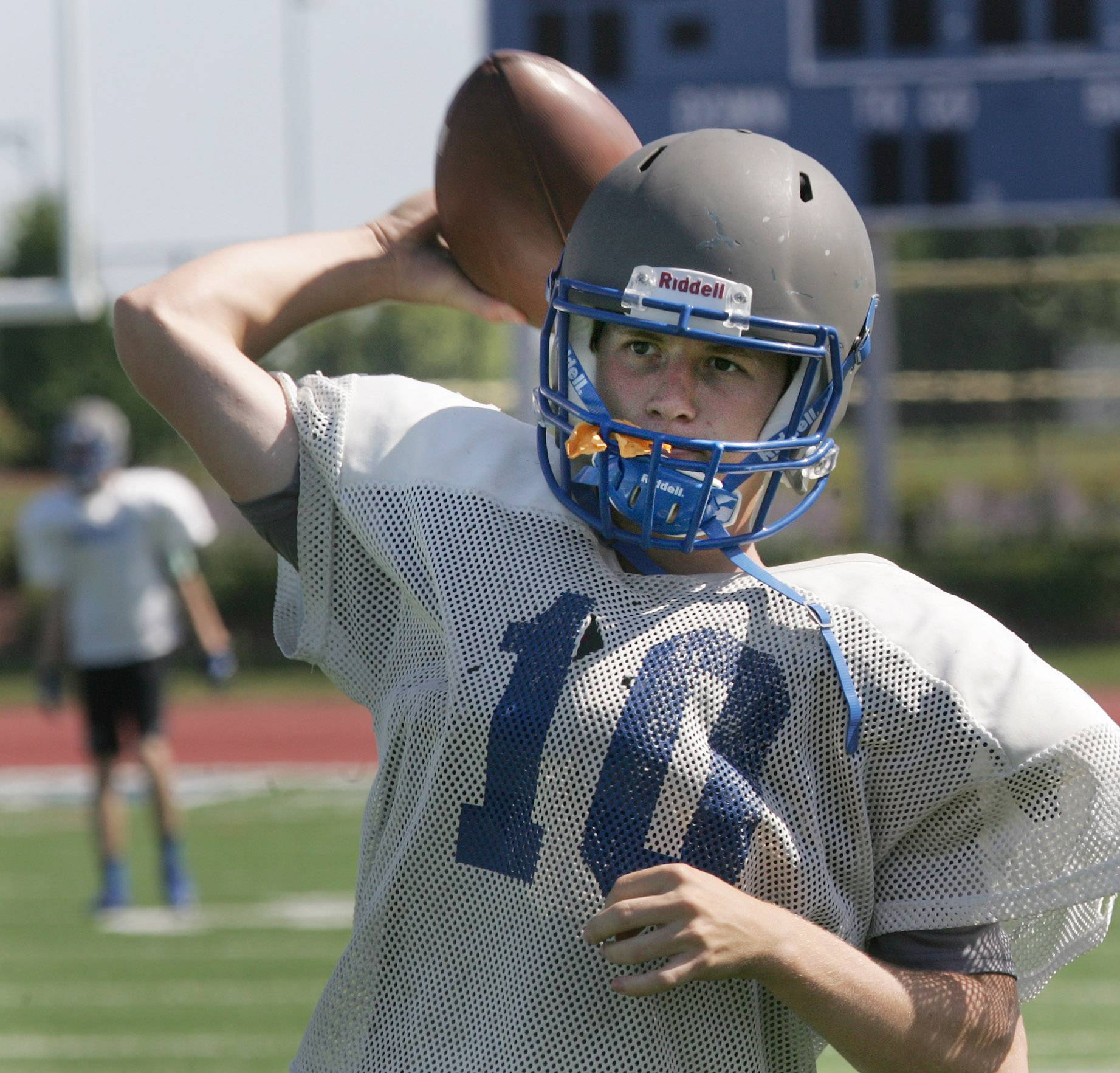 Quarterback Connor McNamara throws the ball during football practice at Vernon Hills High School Thursday.
