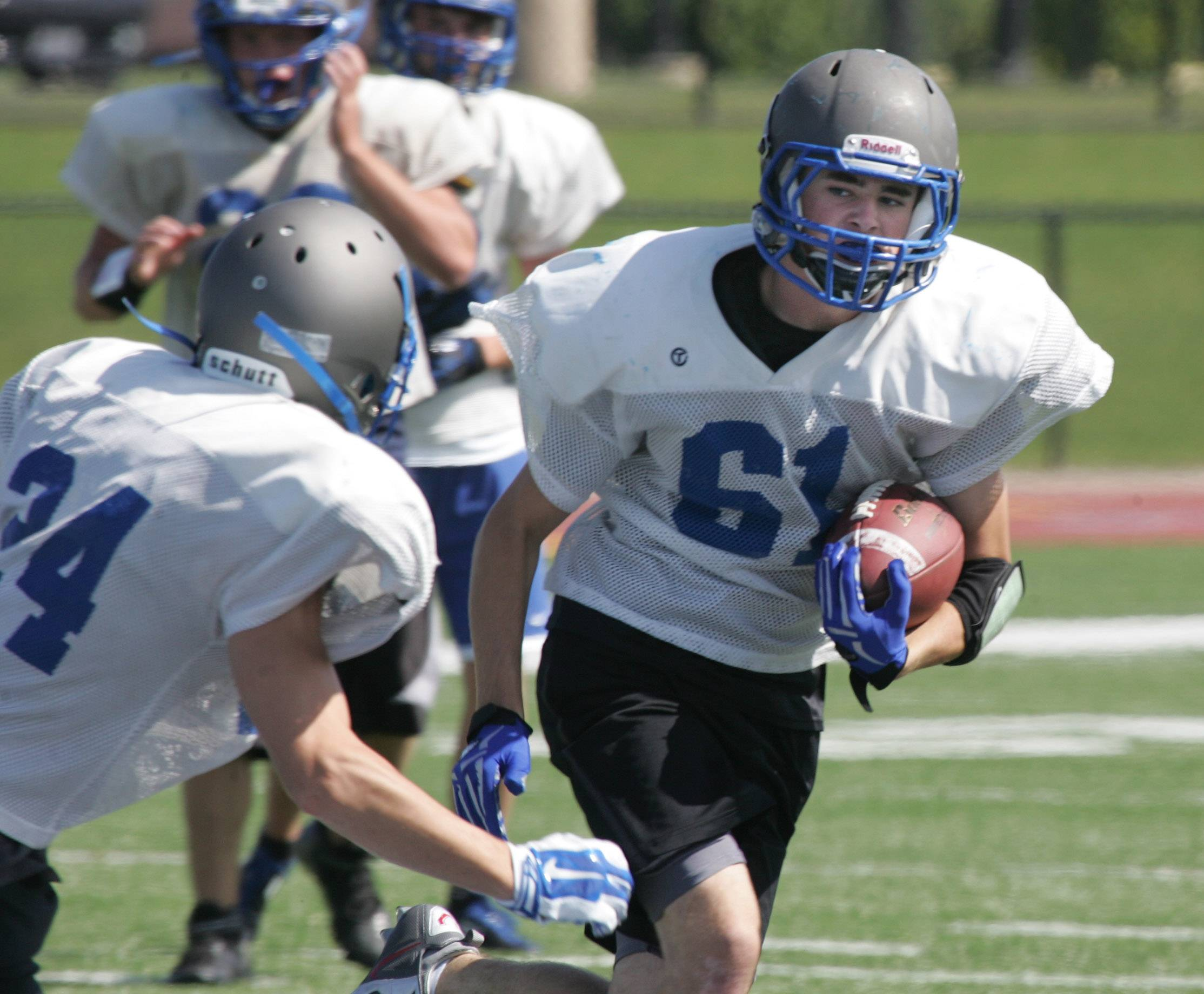 Drew Winegar runs with the ball during football practice at Vernon Hills High School Thursday.