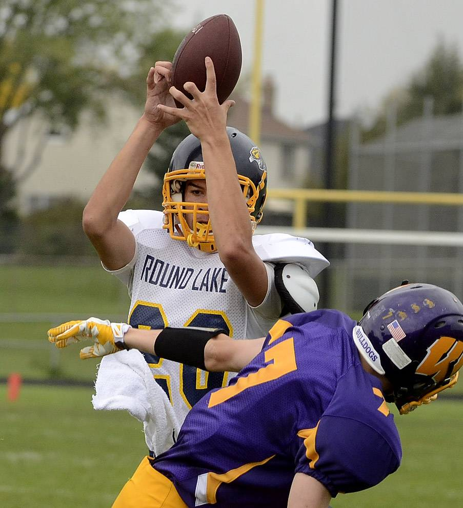 Bob Chwedyk/bchwedyk@dailyherald.com Cole Steger of Round Lake hauls in a first-half touchdown pass over Wauconda's Joey Pausa last season.