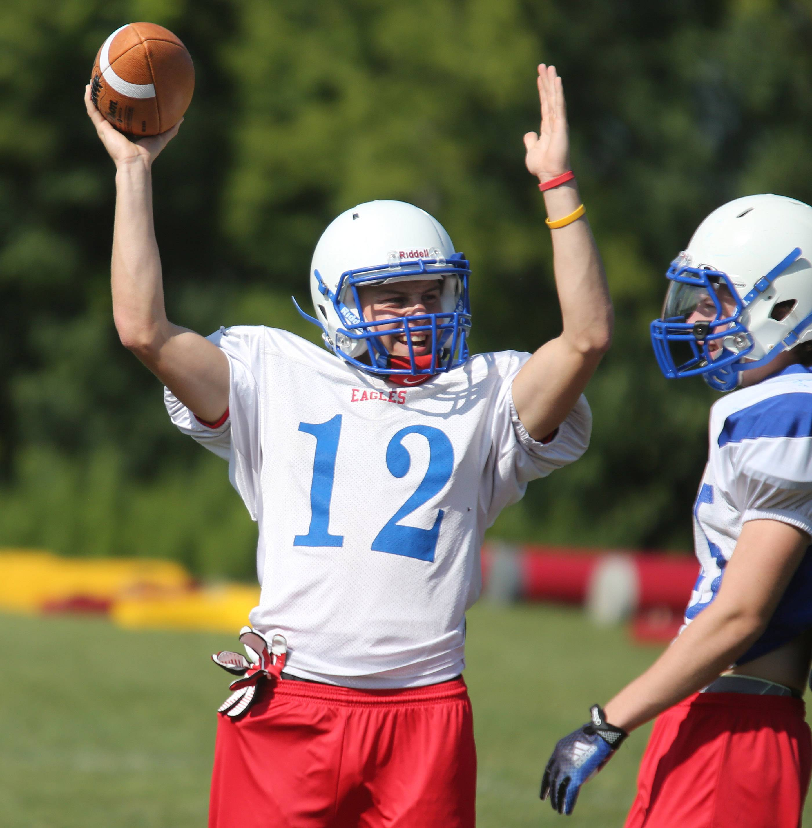Lakes quarterback Jake Balliu signals he is expecting a touchdown on a play during Lakes football practice on Friday in Lake Villa.