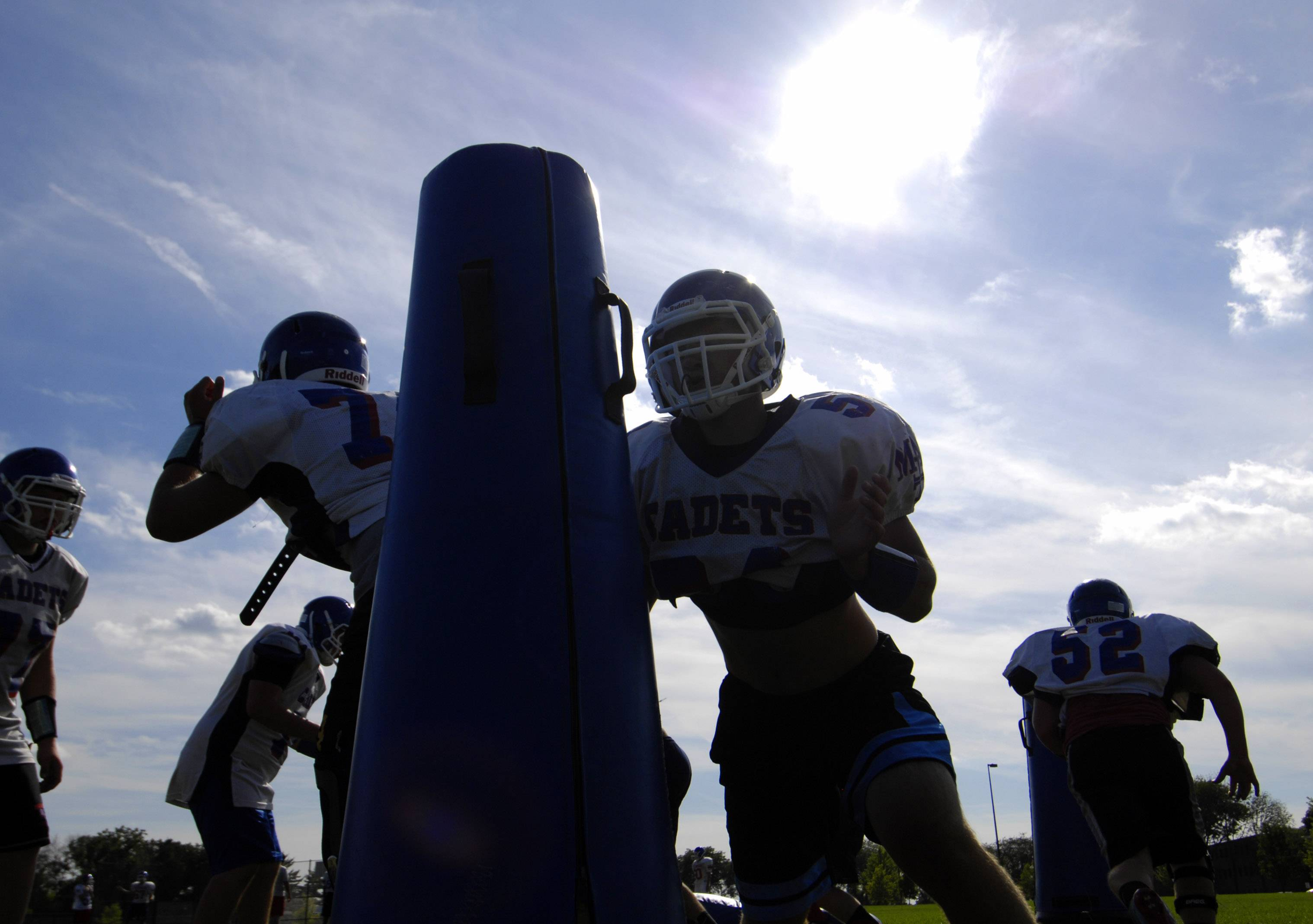 John Starks/jstarks@dailyherald.comLinemen run plays Thursday at the Marmion Academy football practice in Aurora.