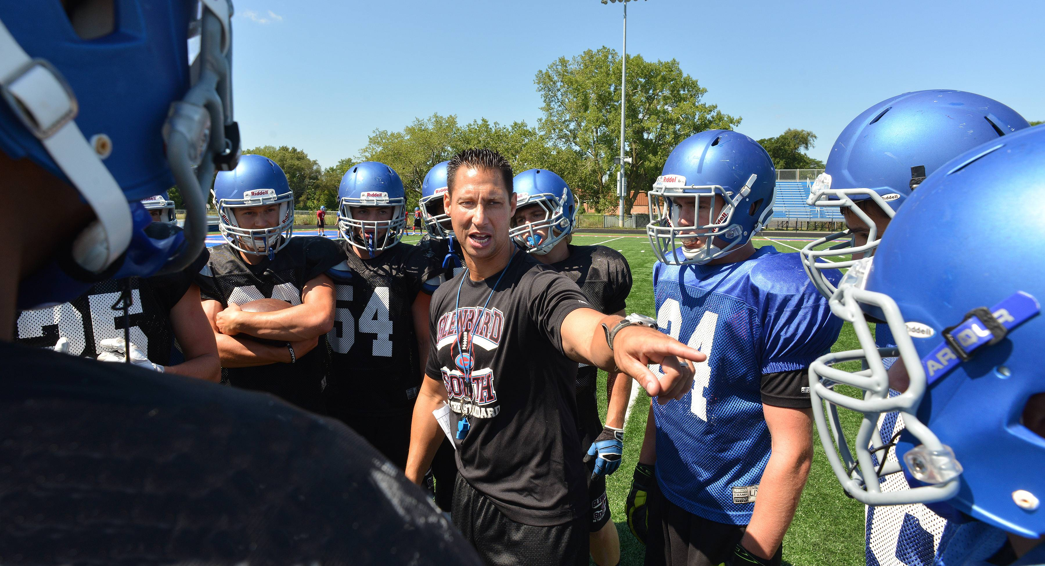 Scott Sanders/ssanders@dailyherald.comGlenbard South varsity football team works out Thursday morning. Head coach Jeremy Cordell gives instructions during practice.