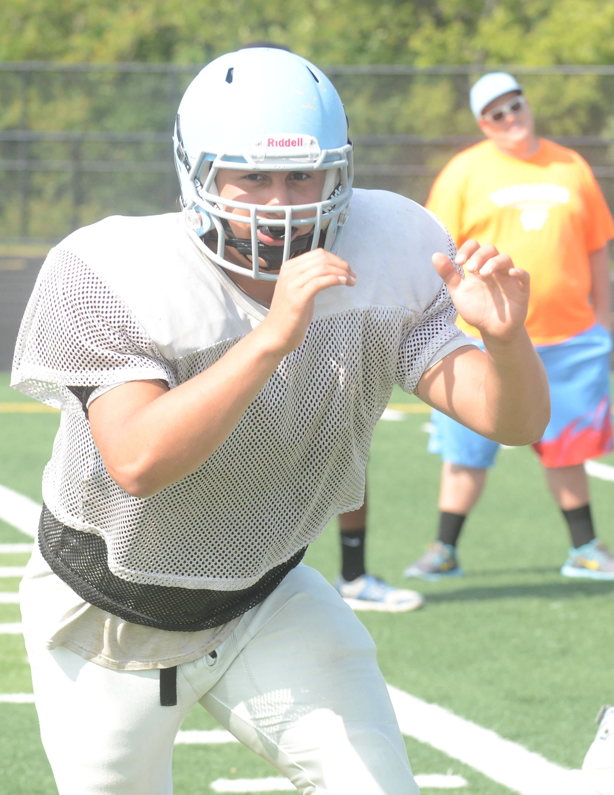 Willowbrook football player Christian Chavez works the line during practice Wednesday.