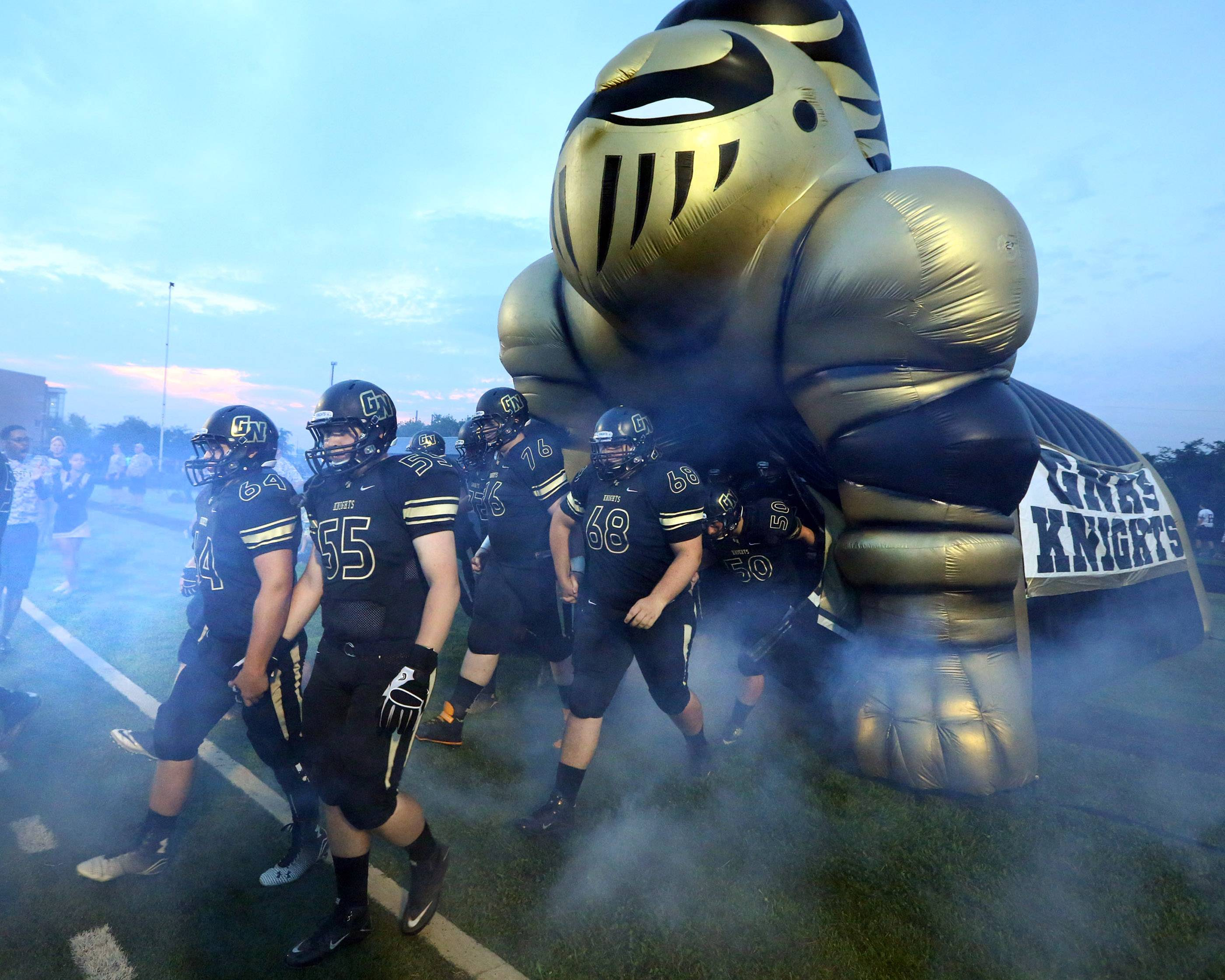 Grayslake North players take the field to play Lakes at Grayslake North on Friday.