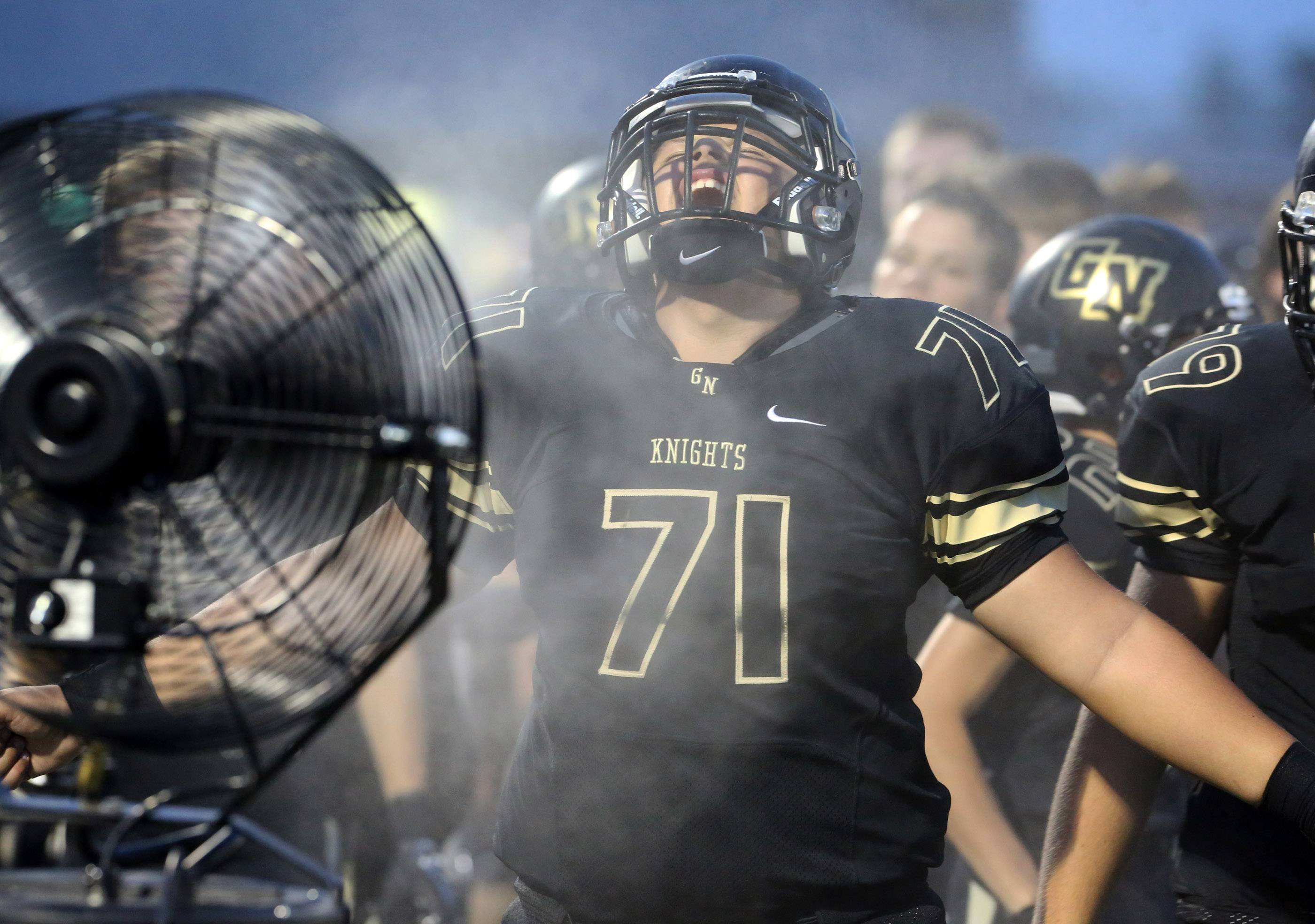 Grayslake North lineman Jack Rutkowski yells as he cools off on the sideline.
