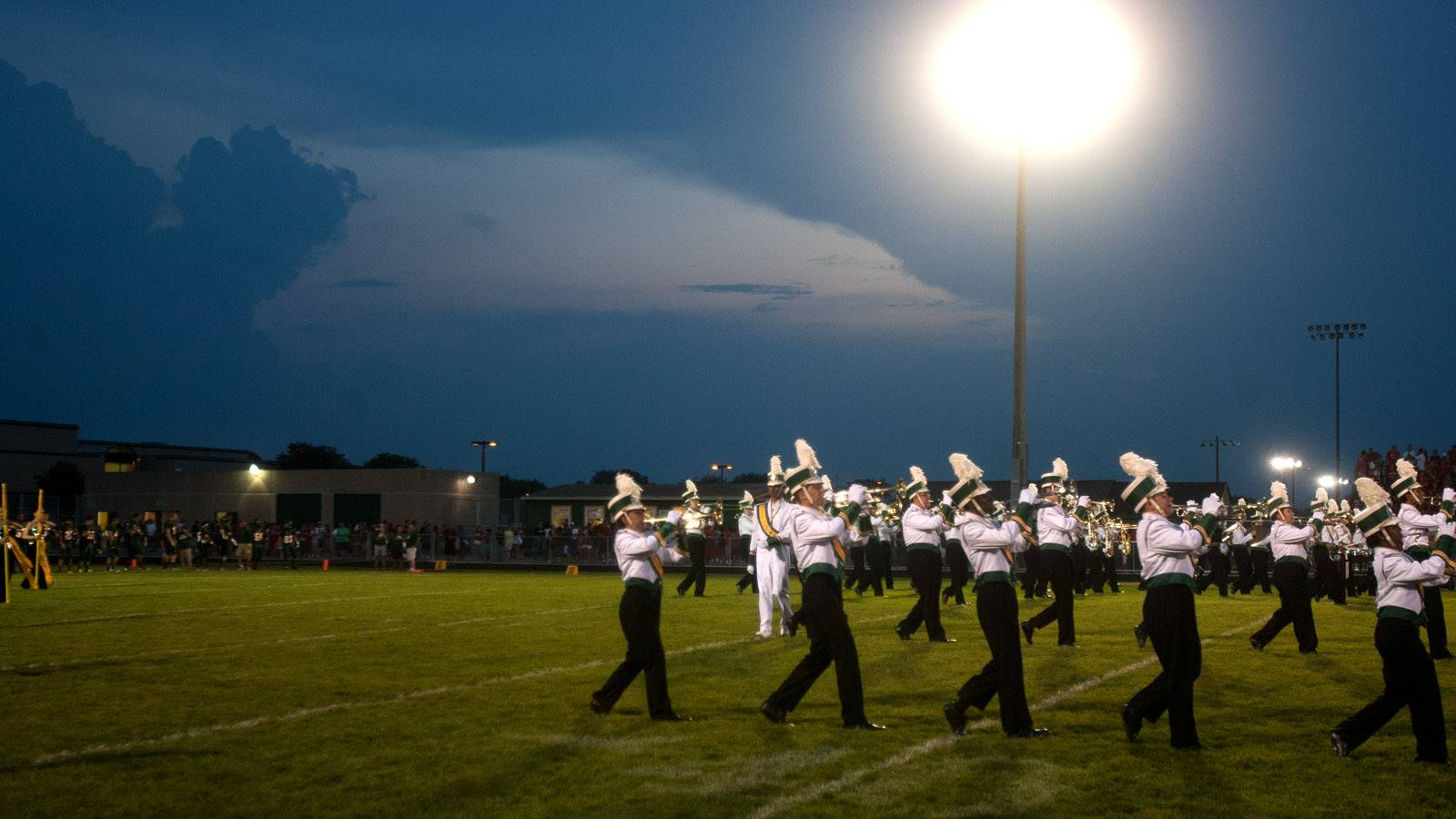 The Waubonsie Valley band plays under ominous skies before the start of the game.