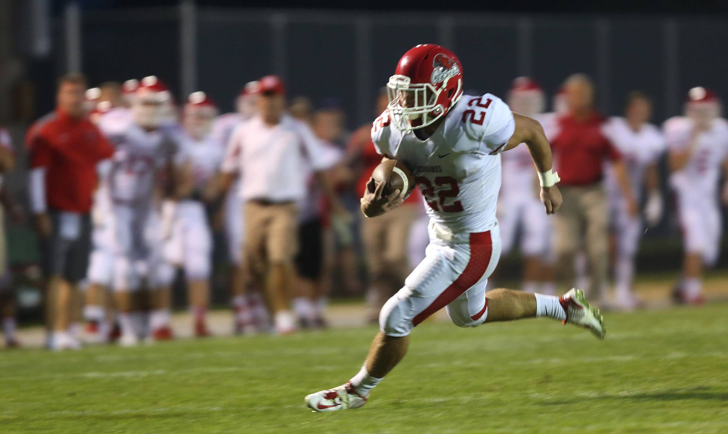 Naperville Central's Kevin Clifford sprints to the two-yard line against Waubonsie Valley.