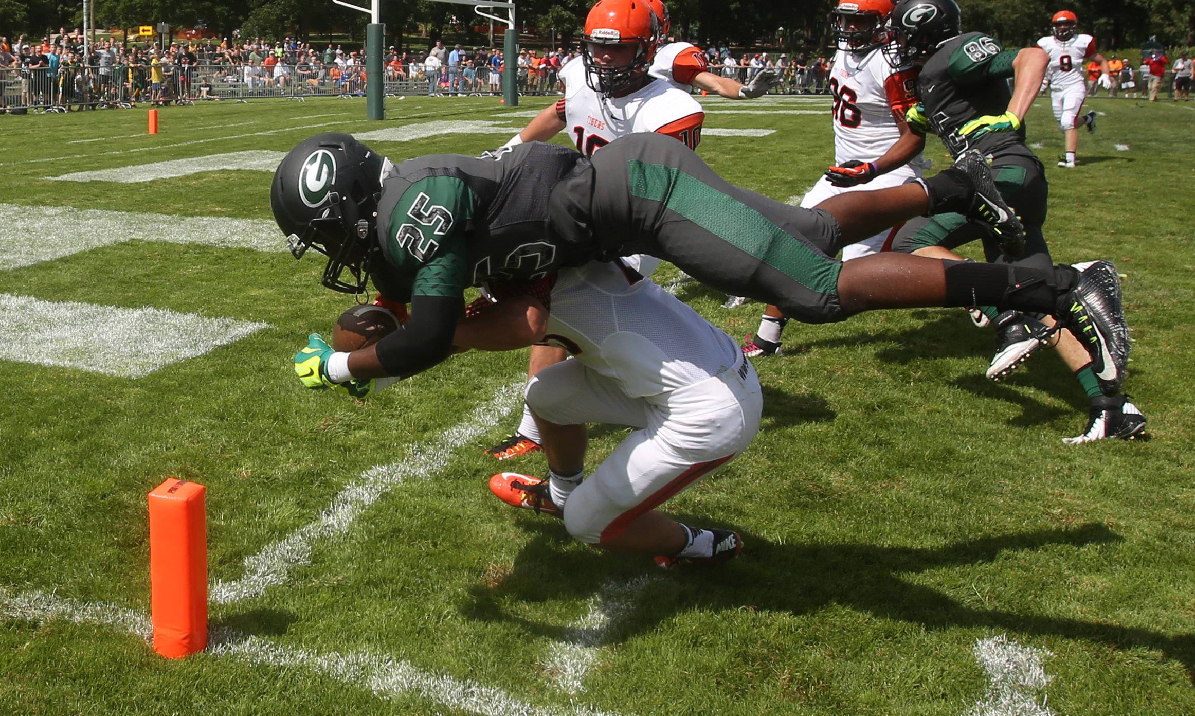 Glenbard West's Donahvon Vaughn is upended by Wheaton Warrenville South's Jake Kyllonen at the one foot line during first half action at Duchon Field.