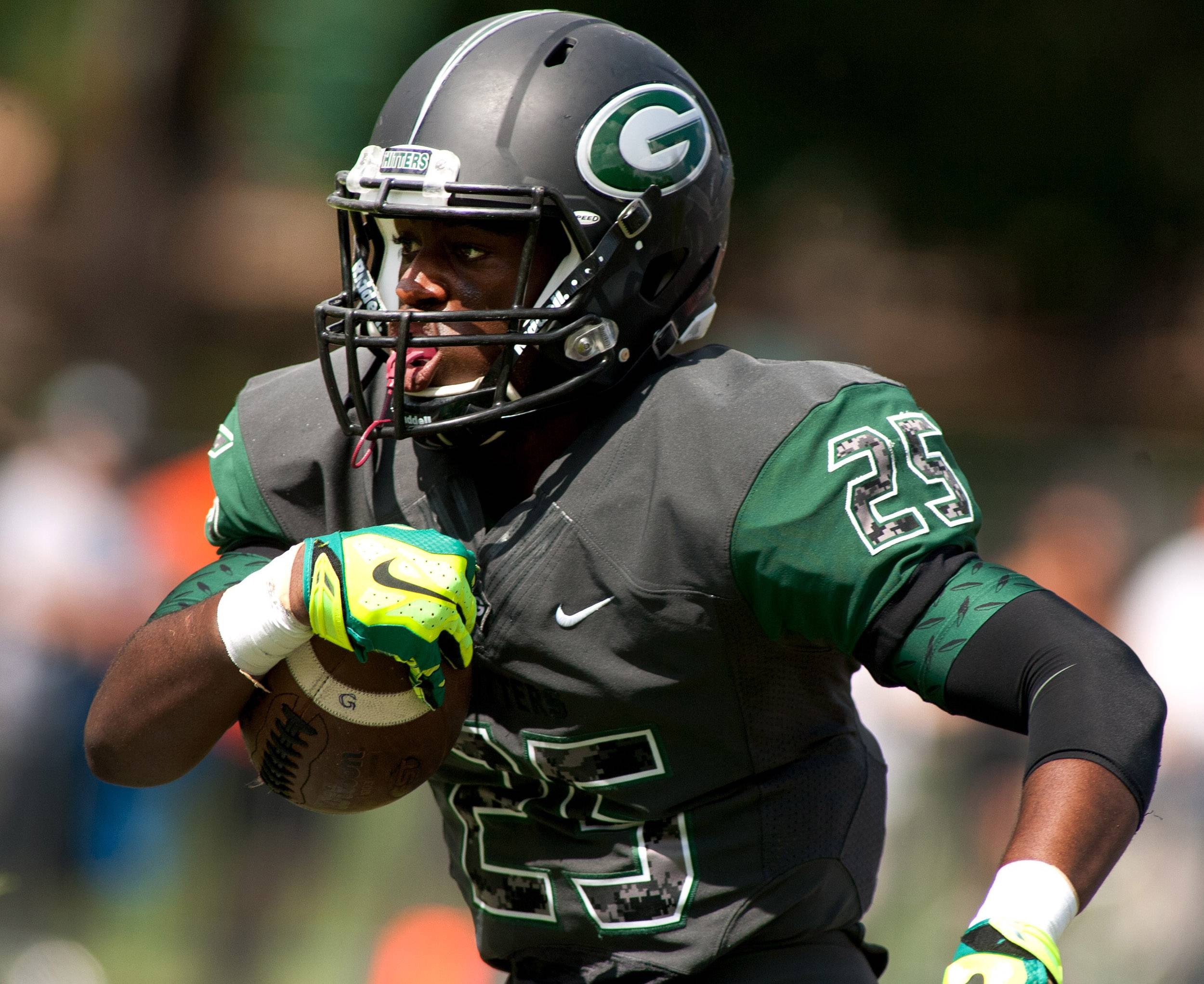 Glenbard West's Donahvon Vaughn eyes the end zone during first half action against Wheaton Warrenville South.
