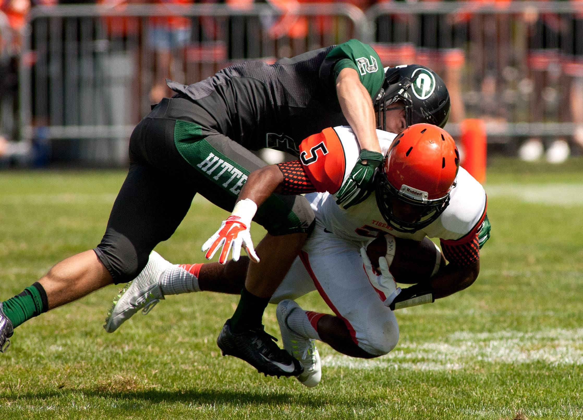 Glenbard West's Ben Marcus wraps up Wheaton Warrenville South's Keishawn Watson.