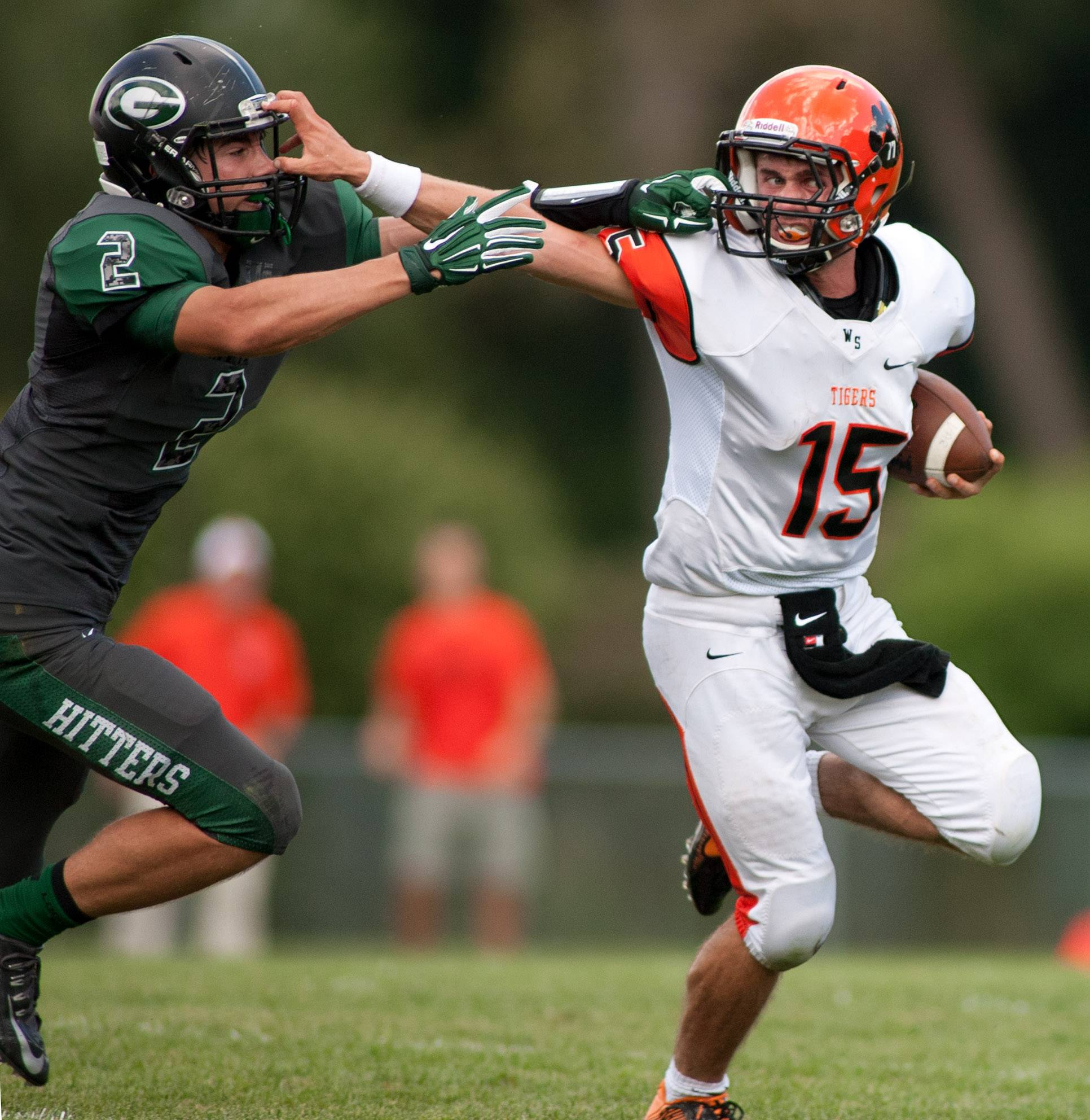 Glenbard West's Ben Marcus, left, and Wheaton Warrenville's Josh Prueter, right, tangle during first half action at Duchon Field.