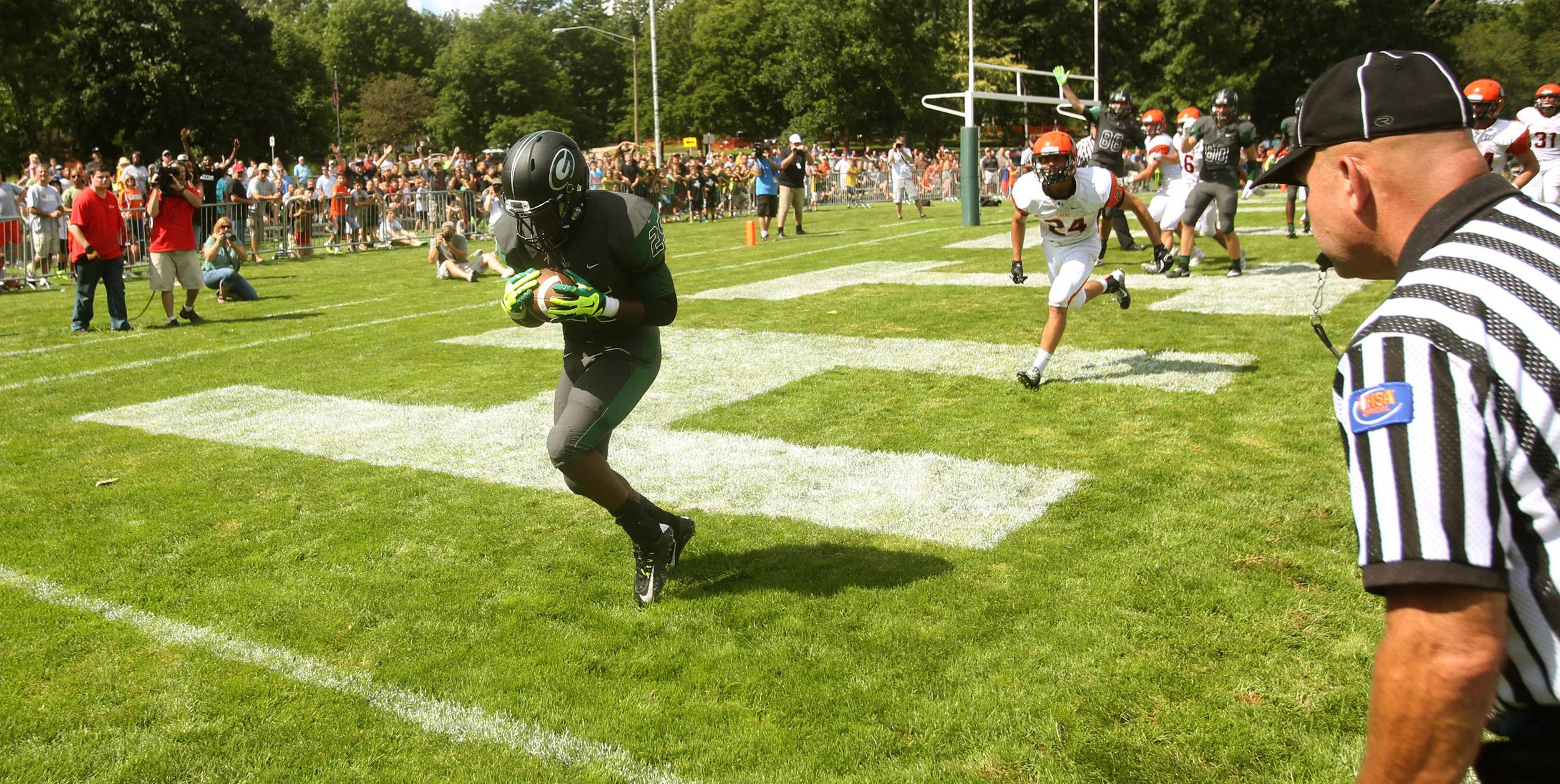 Glenbard West's Donahvon Vaughn scores his second touchdown of the first half against Wheaton Warrenville South, as he catches a 4th down play-action pass.