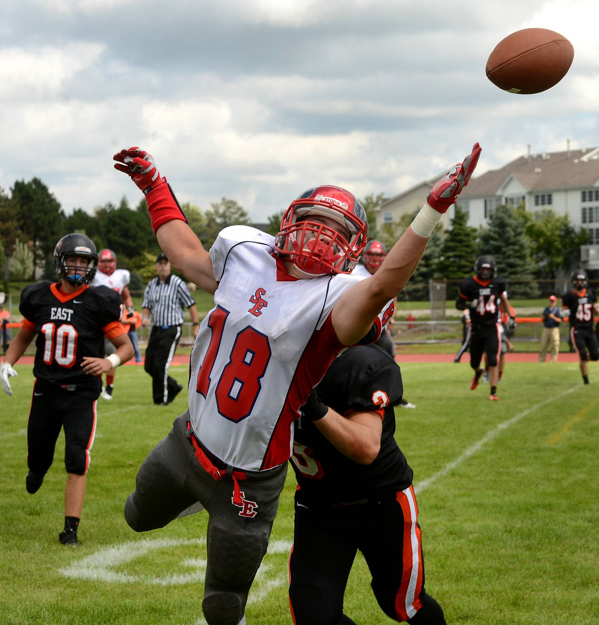Nick Menken of South Elgin stretches for a pass just out of reach while being defended by Tommy Fink of St. Charles, during second quarter action of South Elgin at St. Charles East football.