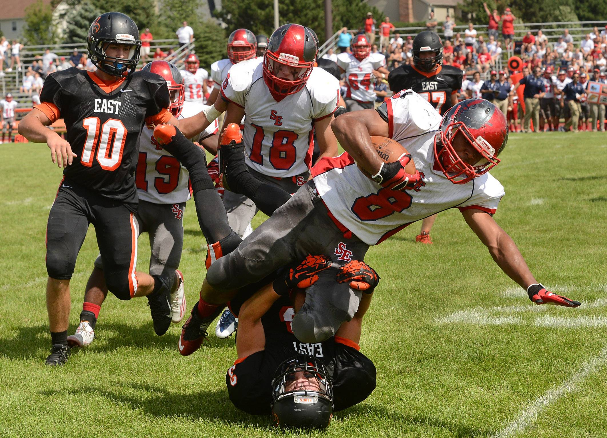 Kyle Ware of South Elgin crashes over St. Charles East's Tommy Fink during the Storm's win Saturday in St. Charles.