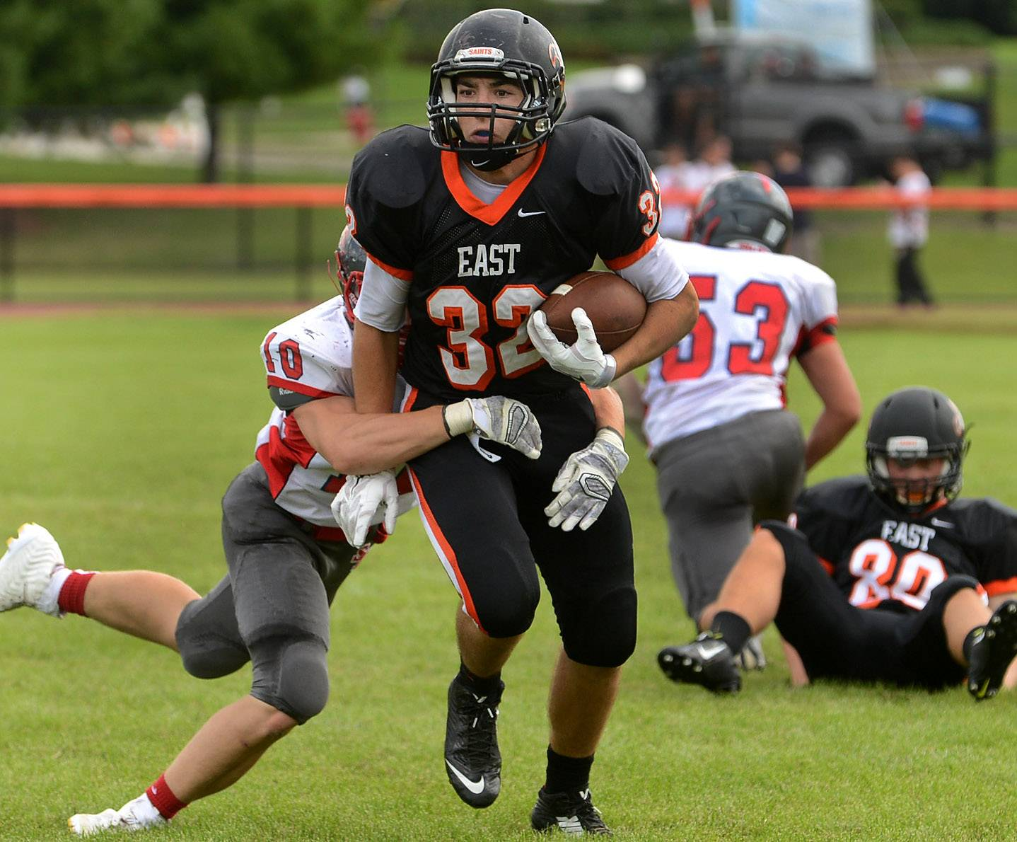 Jake Asquini of St. Charles tries to break into the open after catching a pass in the second quarter of South Elgin at St. Charles East football.