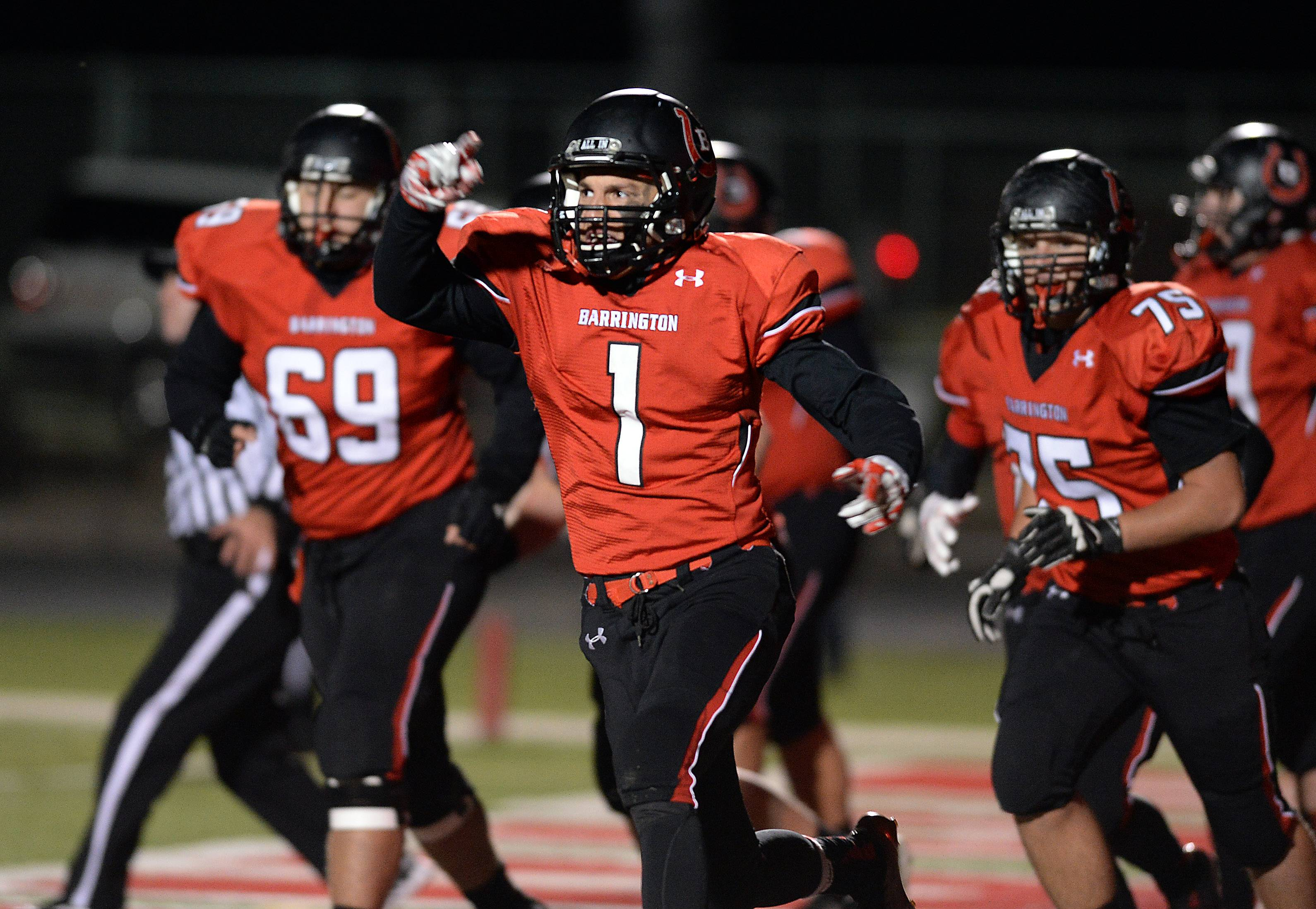 Barrington's Scotty Miller celebrates his first-half touchdown against Oak Park-River Forest in the first round of the Class 8A football playoffs at Barrington.