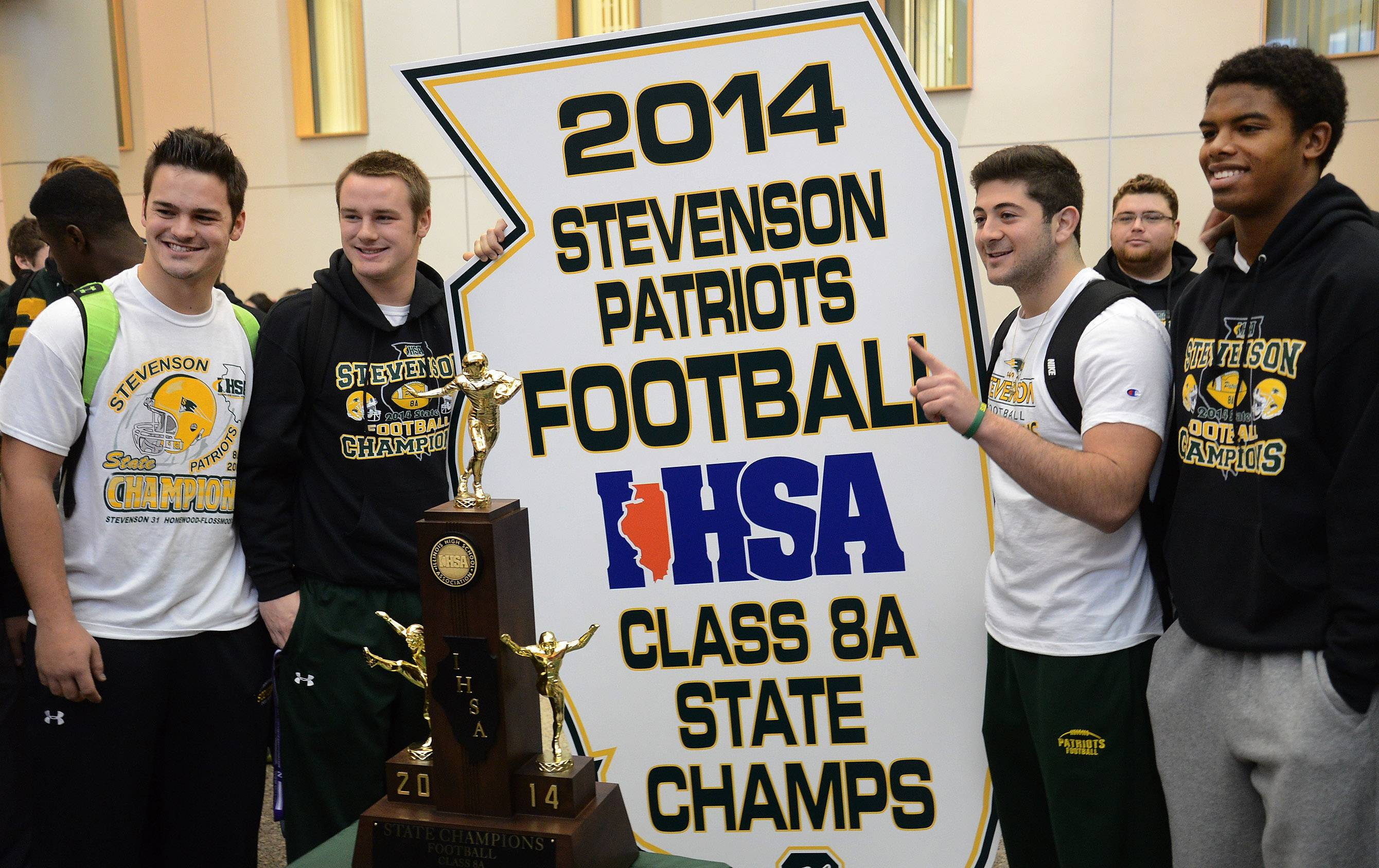 From left seniors, Jason Vravick, Willie Bourbon, Jack Joseph and Cameron Green pose with trophy and state plaque as Stevenson High School celebrates winning the state Class 8A football championship.