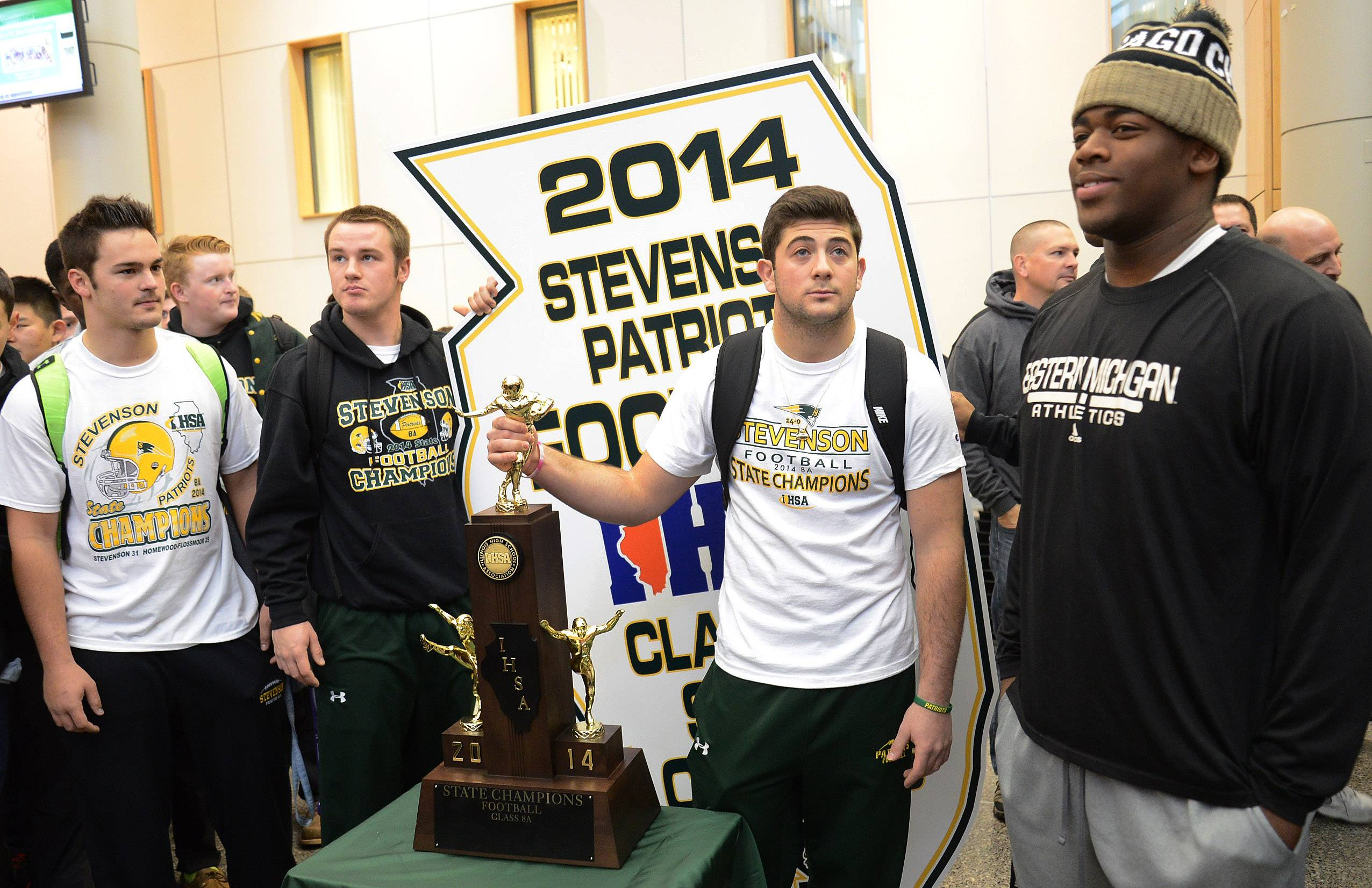 From left seniors, Jason Vravick, Willie Bourbon, Jack Joseph and Nick Dillon pose with trophy and state plaque as Stevenson High School celebrates winning the state Class 8A football championship.