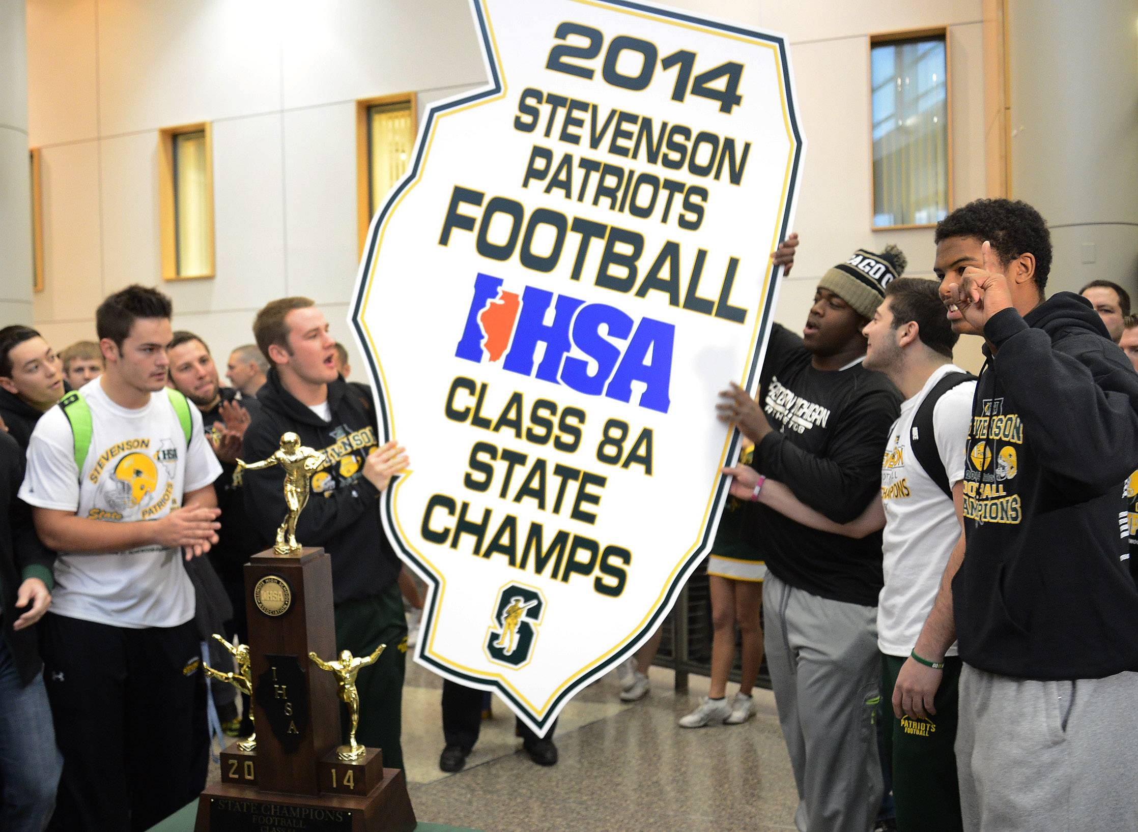 From left seniors, Jason Vravick, Willie Bourbon, Nick Dillon, Jack Joseph and Cameron Green celebrate with trophy and state plaque as Stevenson High School celebrates winning the state Class 8A football championship.