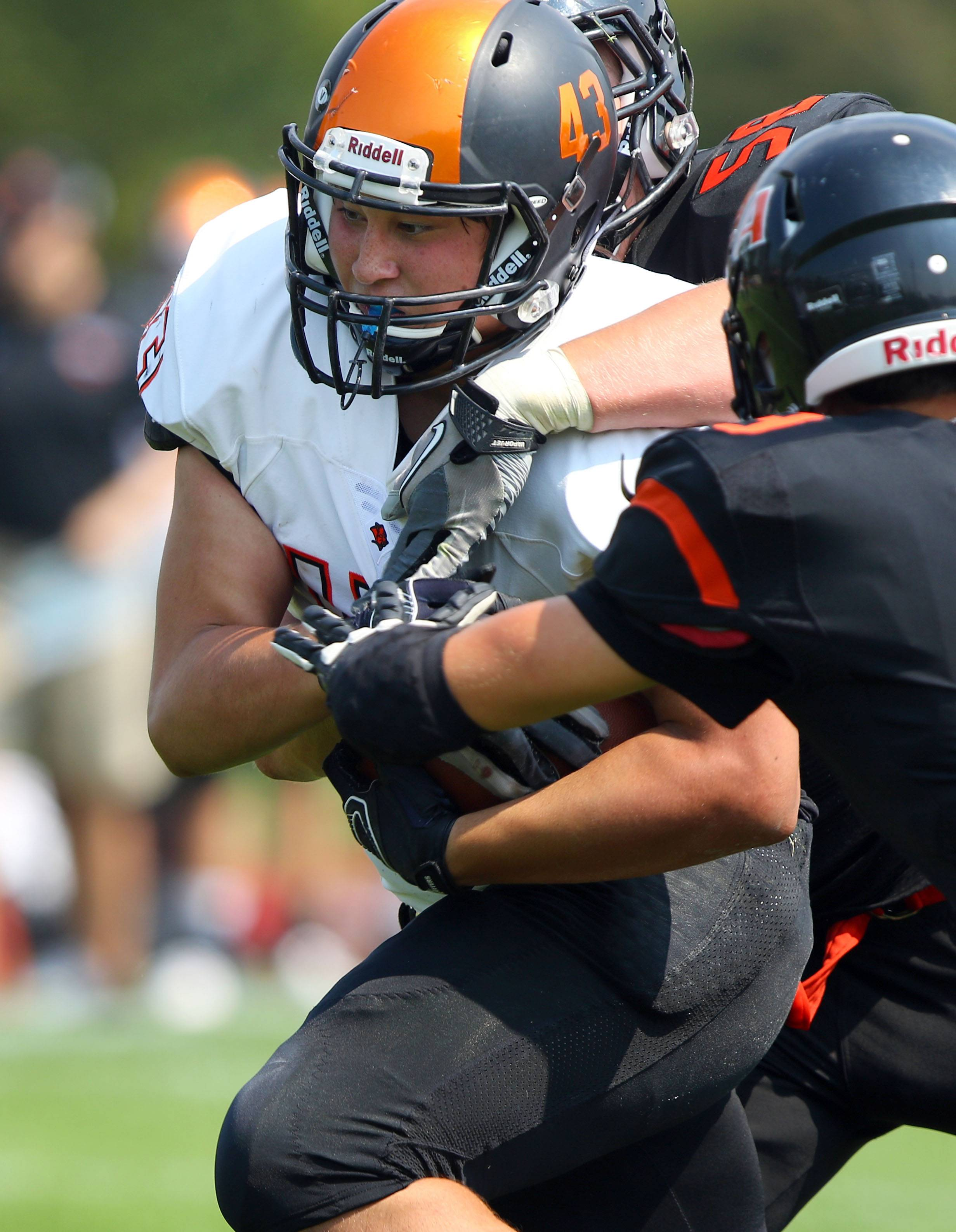 Libertyville's Jason Tse powers through Lake Forest Academy defenders Saturday in Lake Forest.