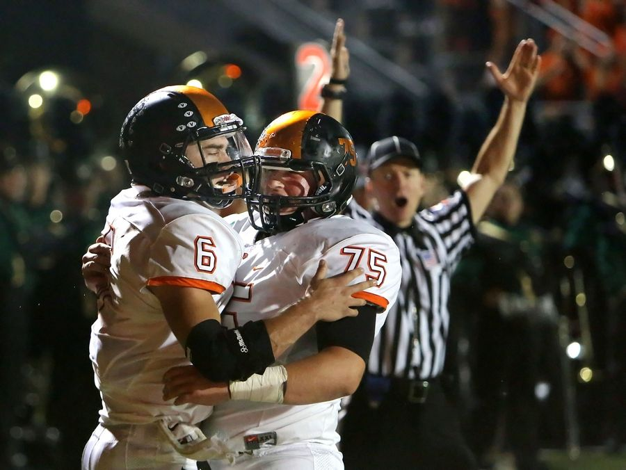 Libertyville's Riley Lees celebrates with Jon Evers (75) after a touchdown during their game Friday night at Stevenson High School in Lincolnshire.