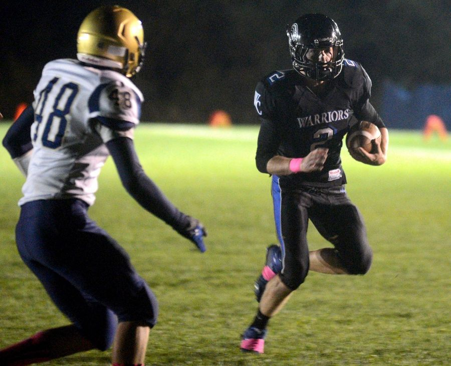 Westminster Christian's Bobby Scott runs the ball against Kirkland Hiawatha in Elgin on Friday night.