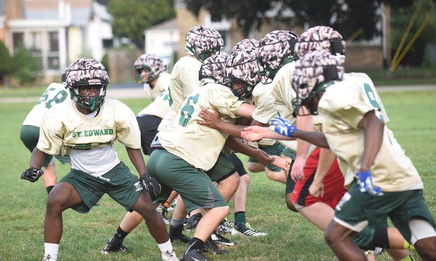 This is the third year the St. Edward High School football team has been using Guardian Caps during practice to reduce concussions.