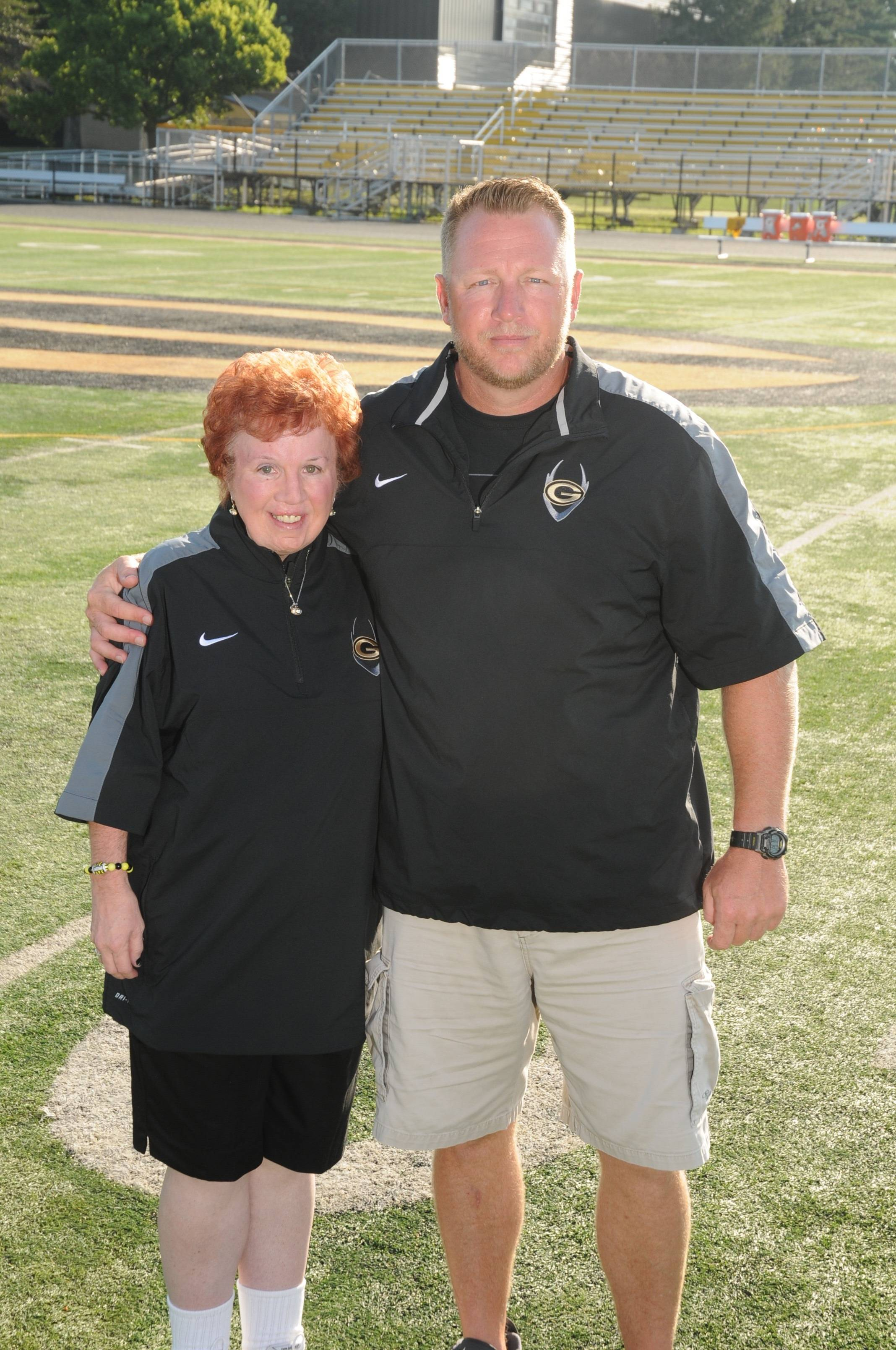 Glenbard North super-fan Cindy Nuti poses with Panthers football coach Ryan Wilkens.