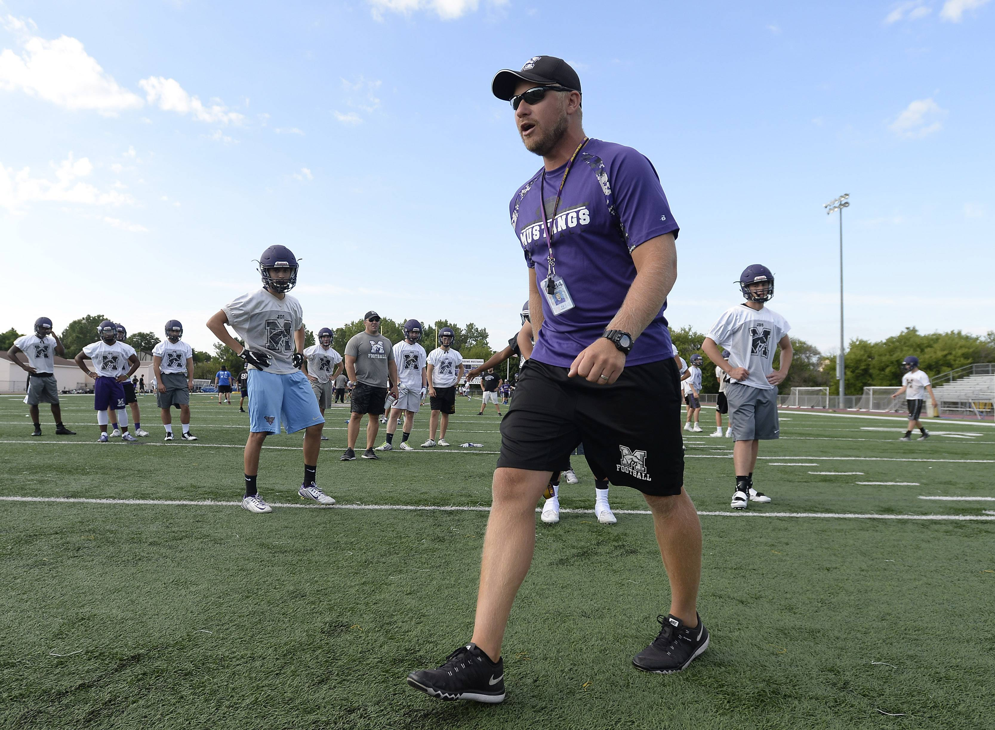 Rolling Meadows coach Matt Mishler gets his group ready for the coming season.
