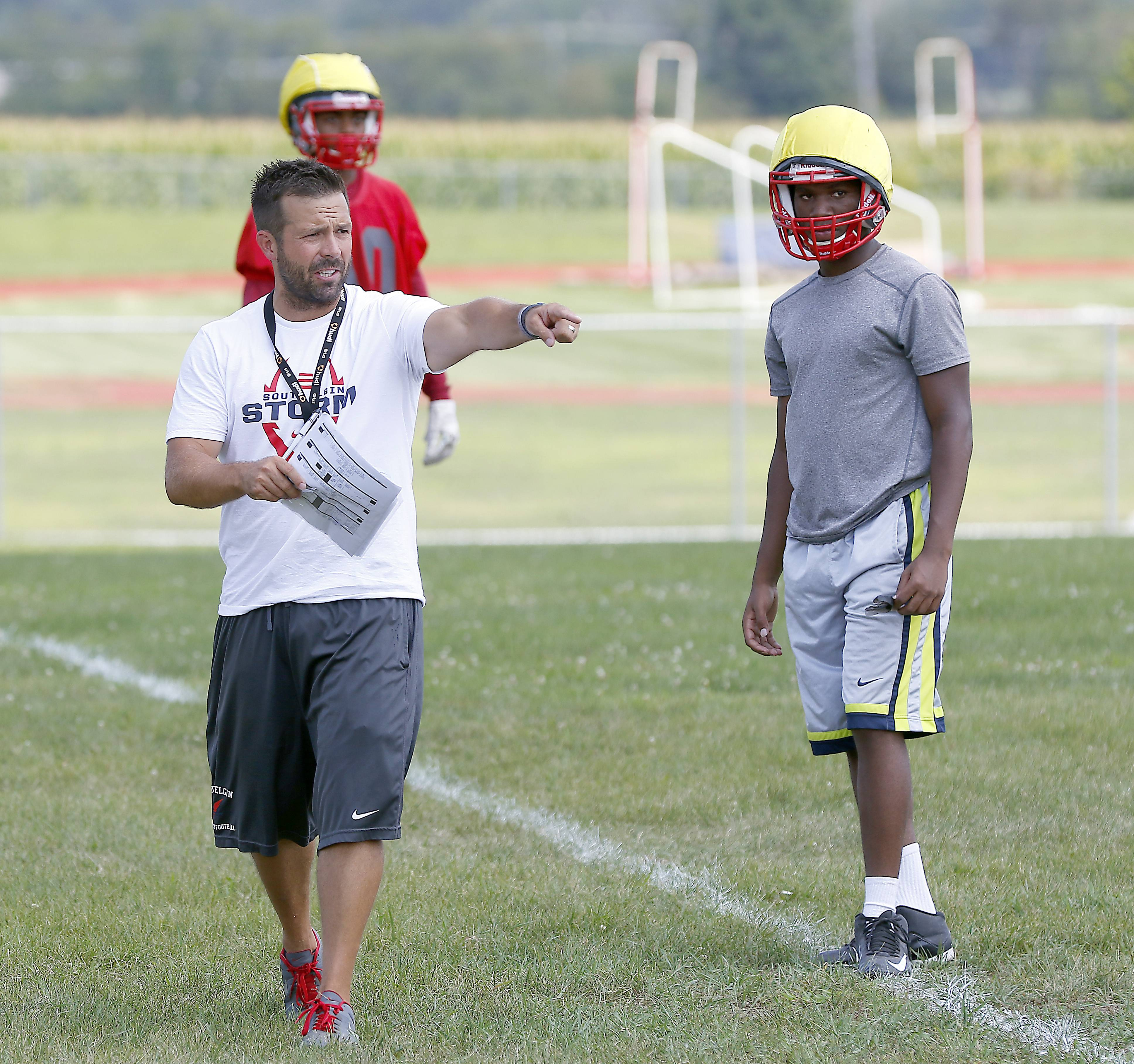 Coach Patrik Pistorio directs his squad Monday during South Elgin football practice.