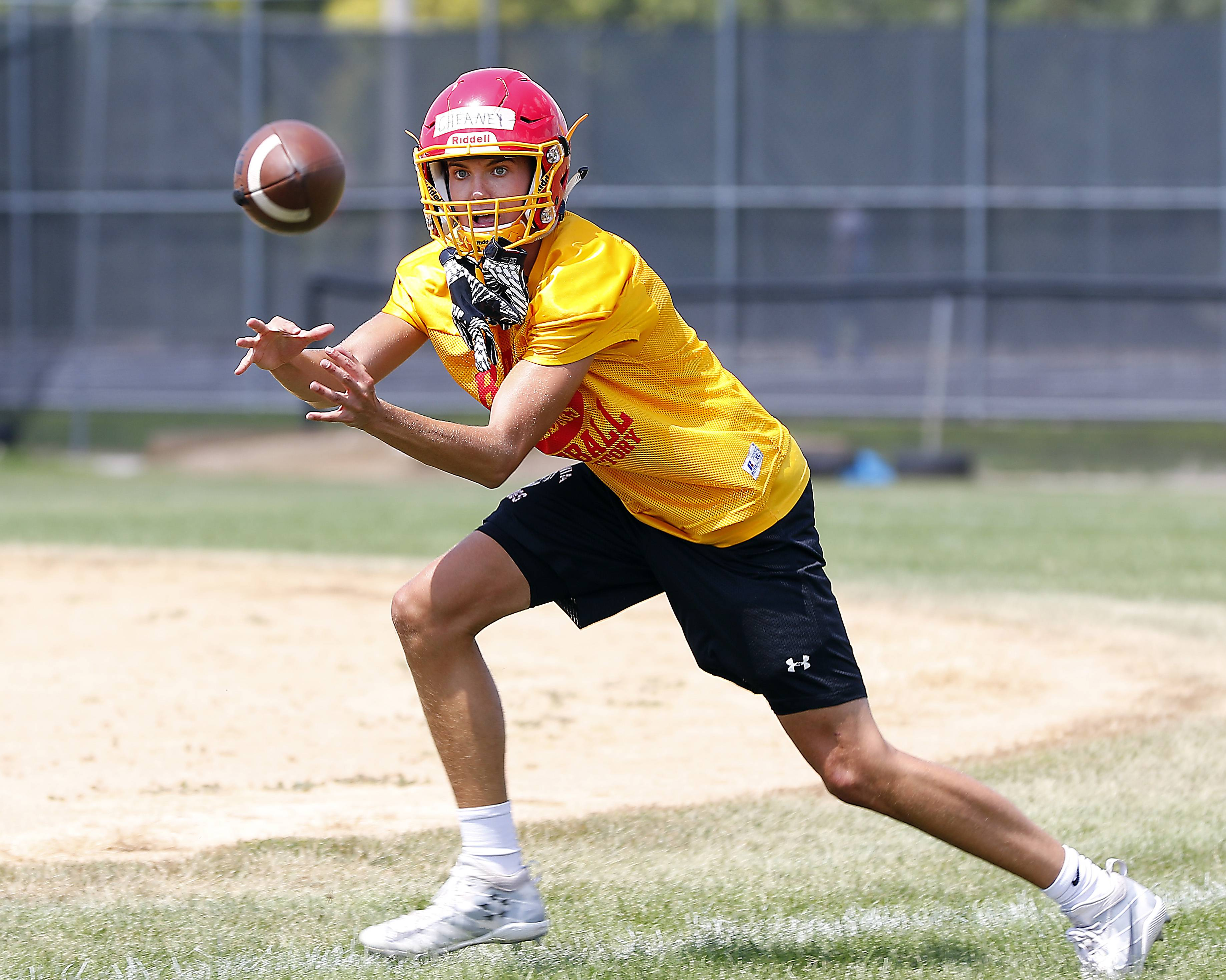 Collin Cheaney reels in a quick pass Monday during Batavia football practice.