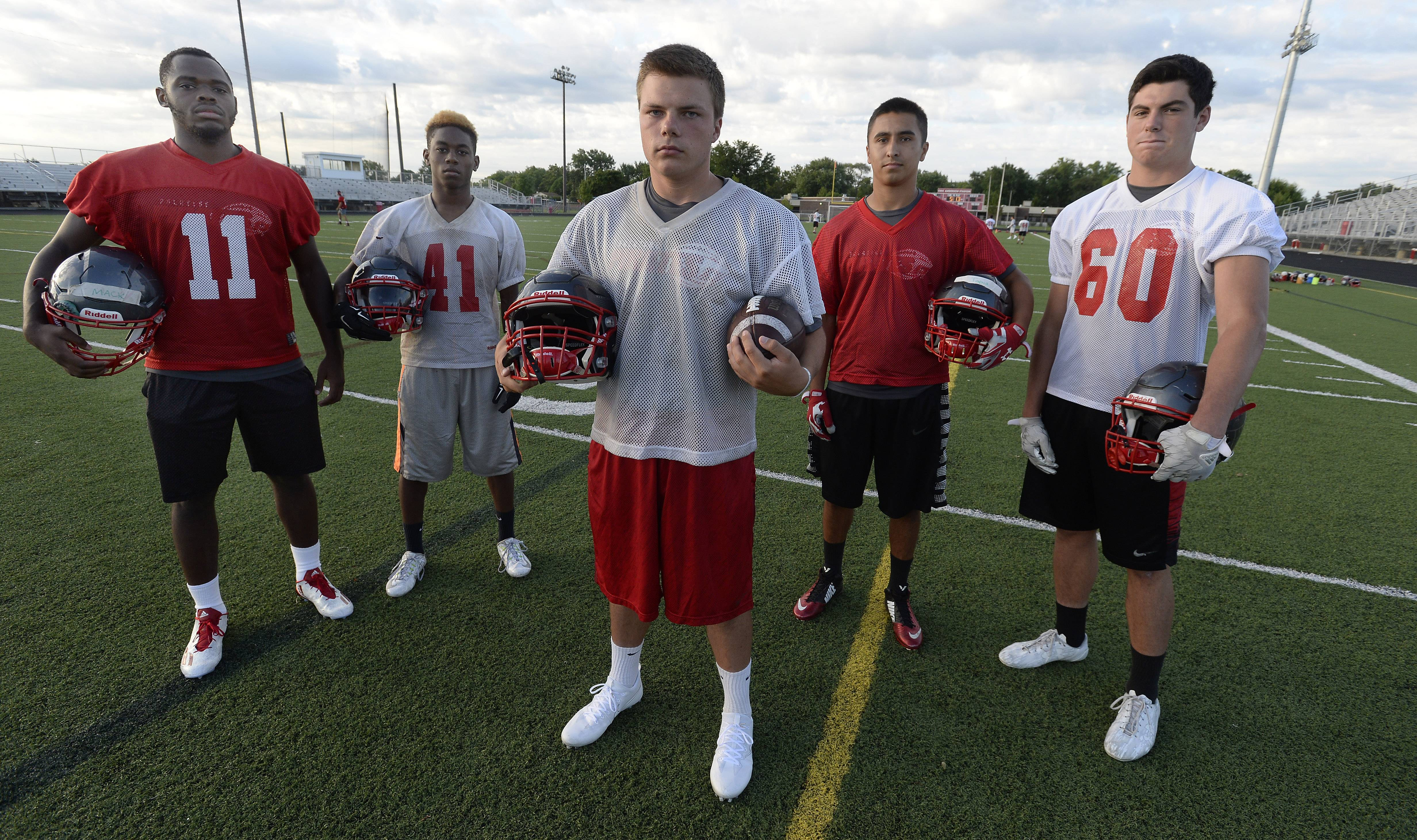 Among the reasons Palatine's football team has high hopes are returning talents, from left, Zach Oles, Mackenzie Balanganayi, Courtland Cornelius, Dylan Tapia and Jack Grochowski.