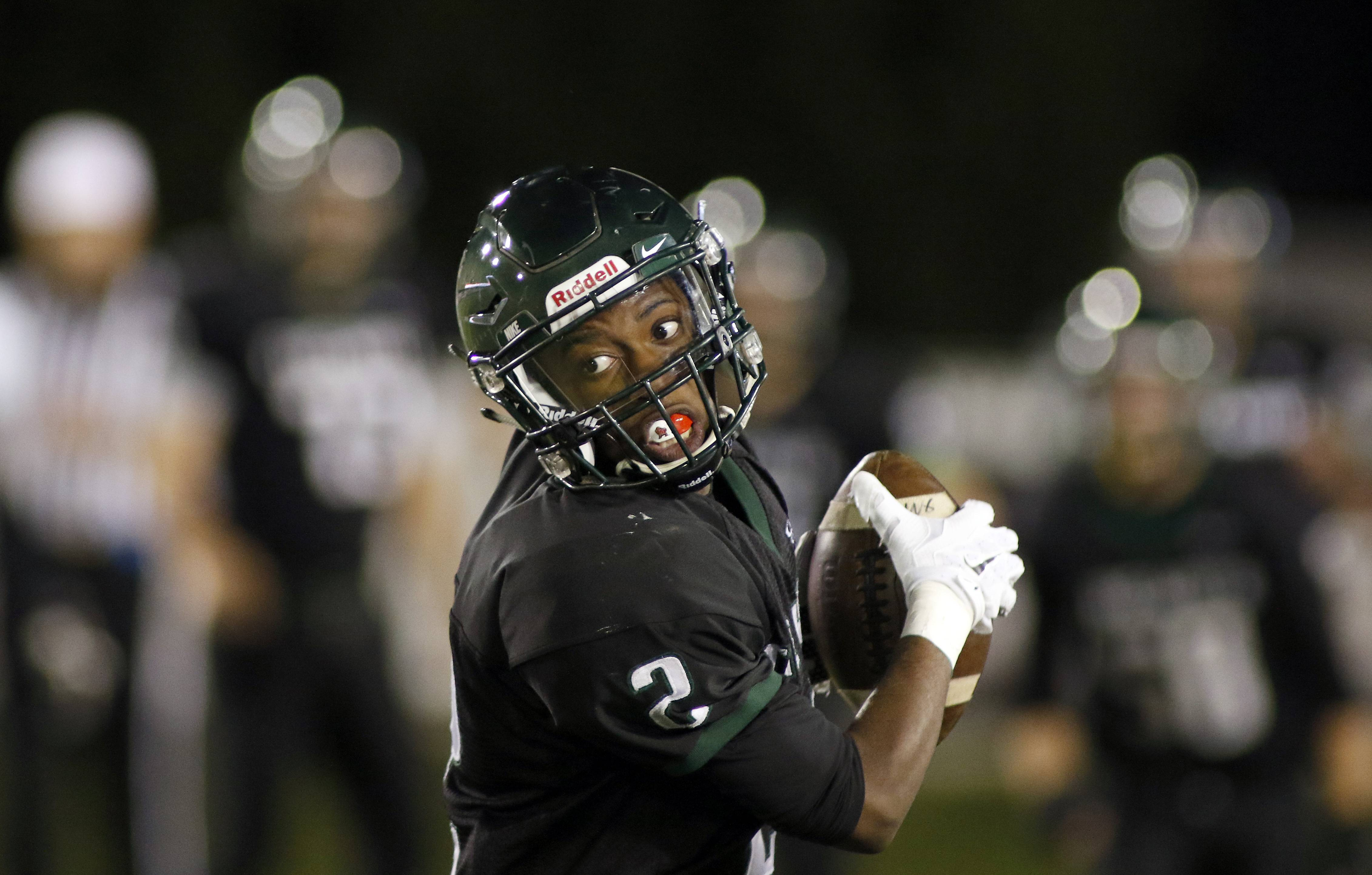 St. Edward's Saveon Smith is one of many talented receivers the Green Wave return this season.