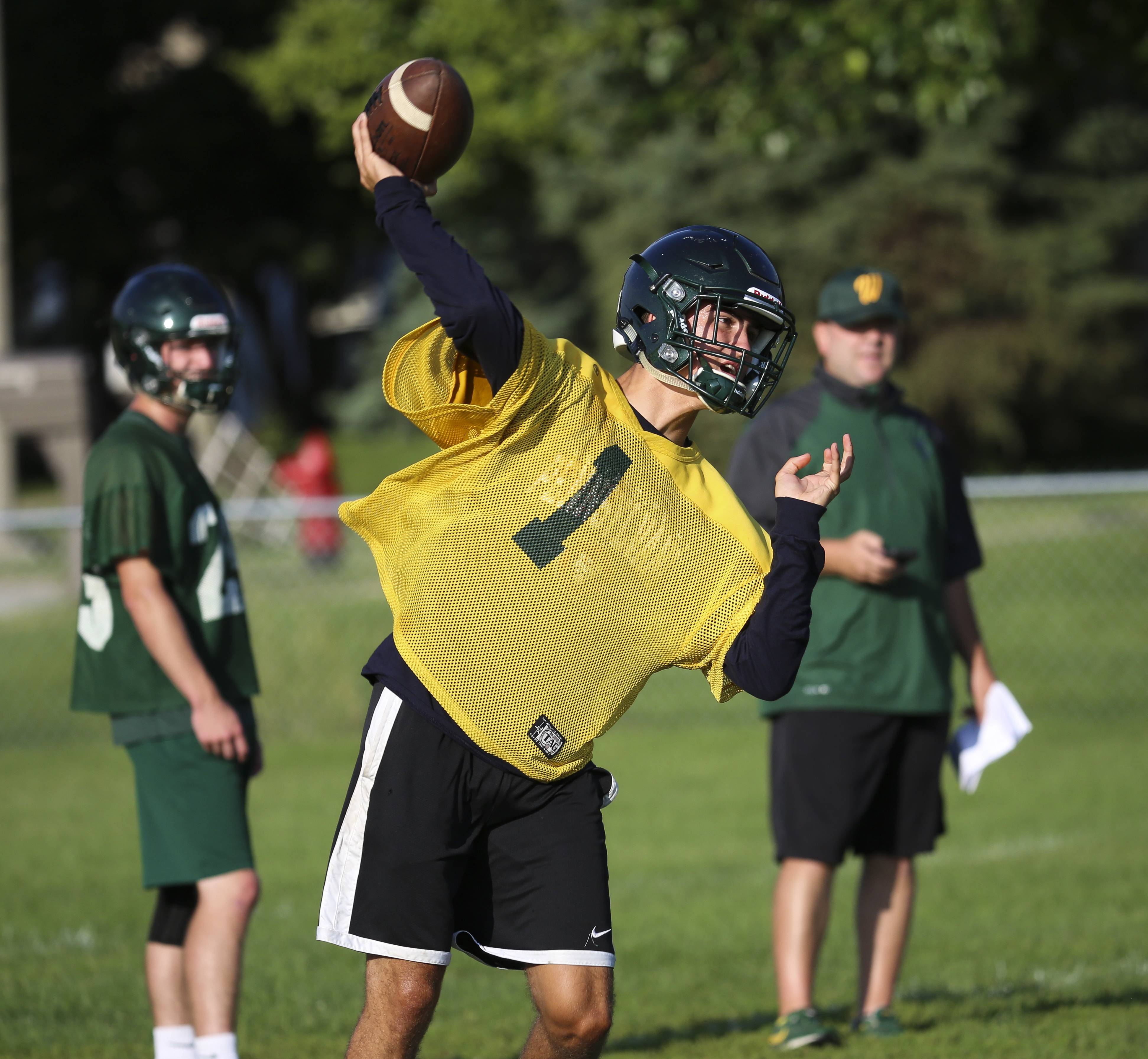 Quarterback Tanner Westwood on the first day of football practice at Waubonsie Valley High School in Aurora on Monday.
