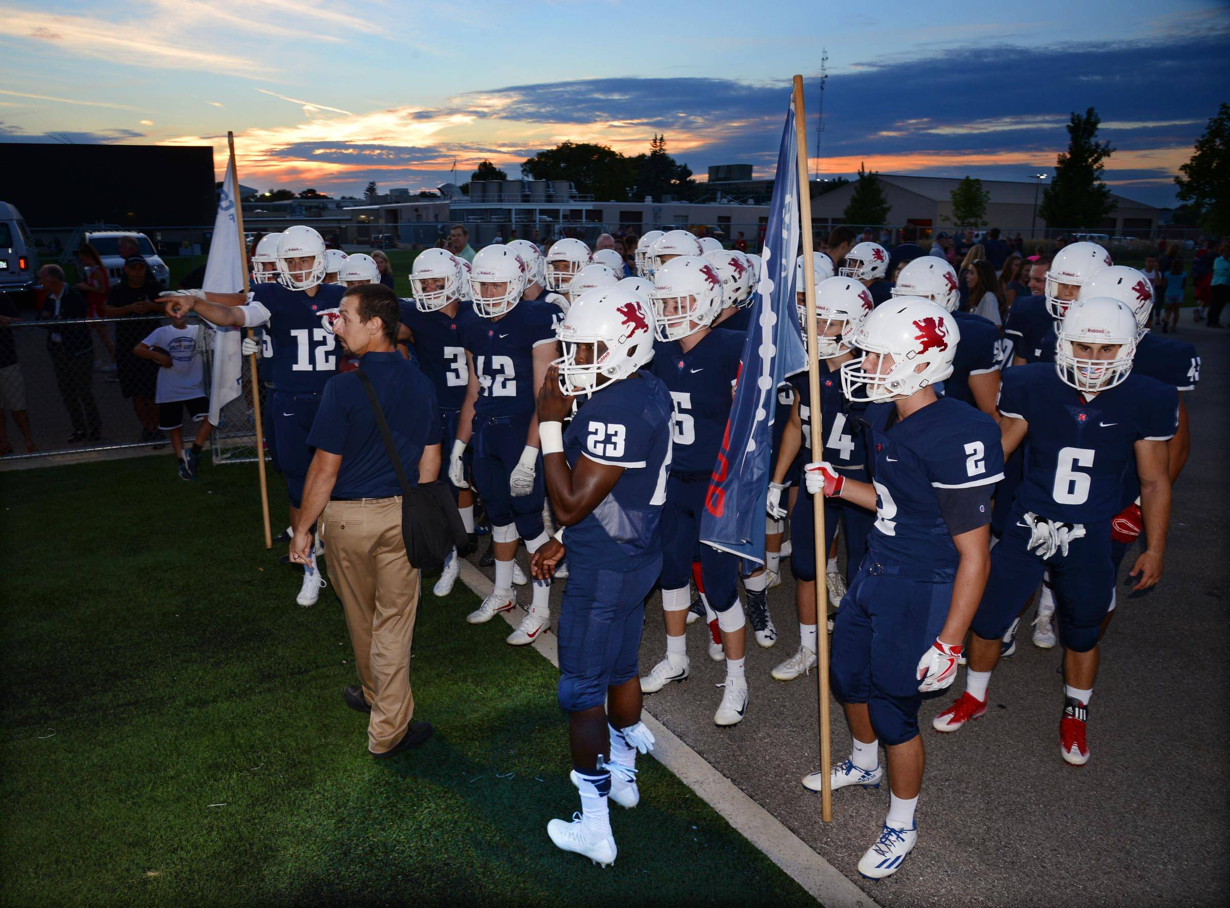 St. Viator prepares to come onto the field for their season opener against Rolling Meadows on Friday in Arlington Heights.