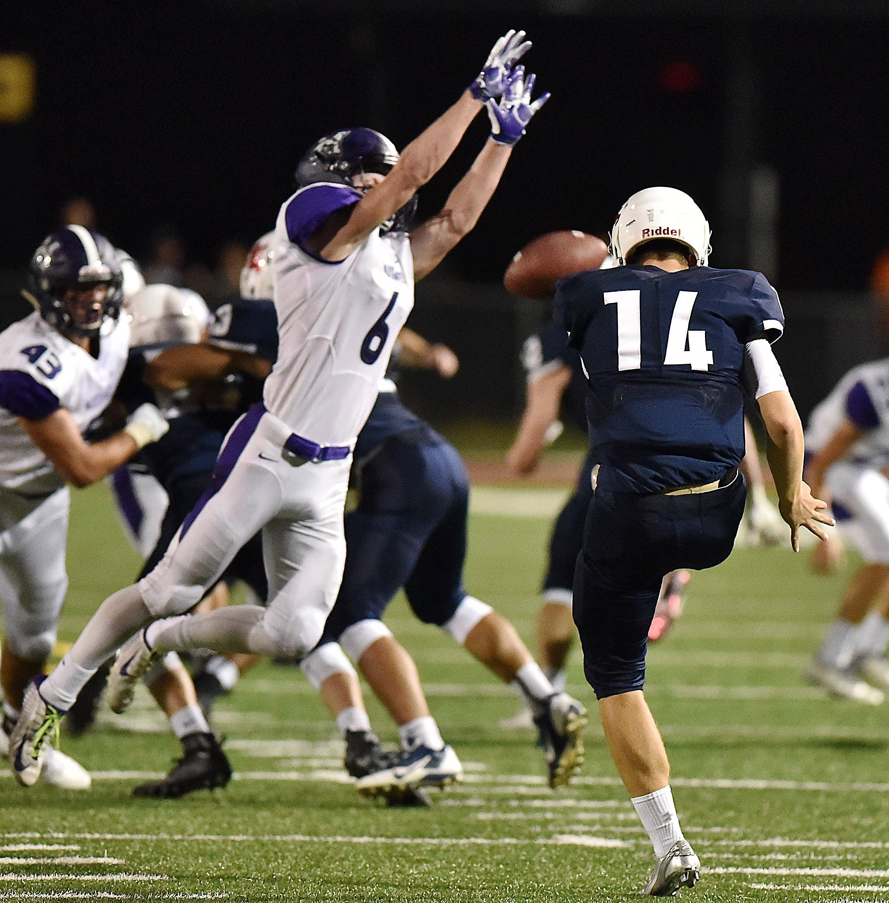 Rolling Meadows' Nick Delporte blocks a punt by St. Viator's Bryce Hellgeth that was then run back for a touchdown by Kevin Haltman on Friday in Arlington Heights.