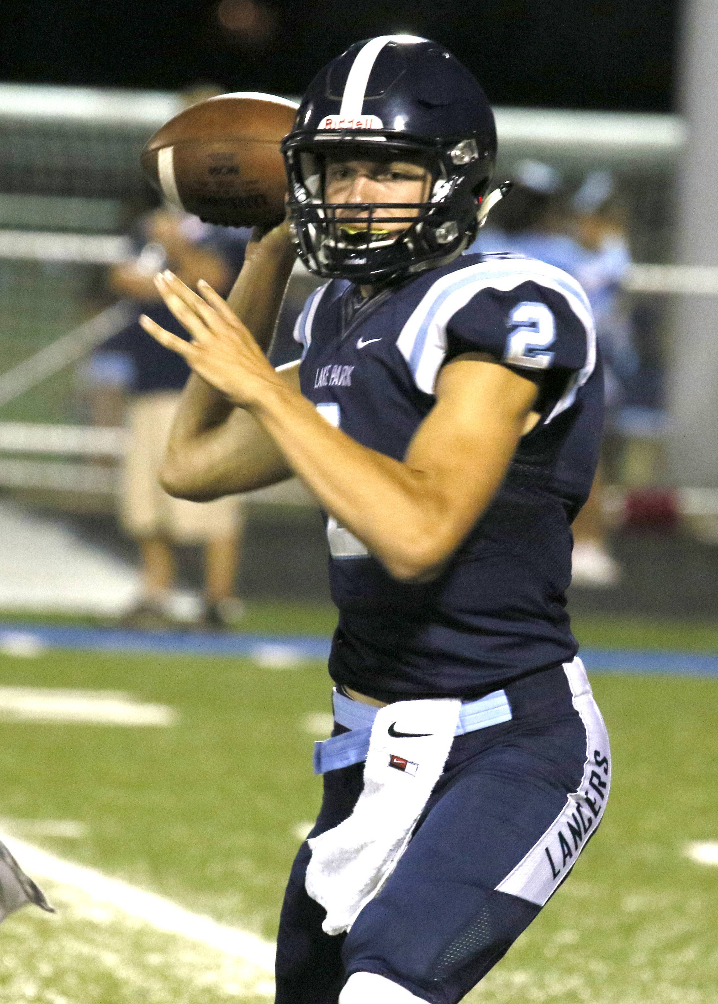Lake Park quarterback Jackson Behles looks to pass against Waubonsie Valley during first half action.