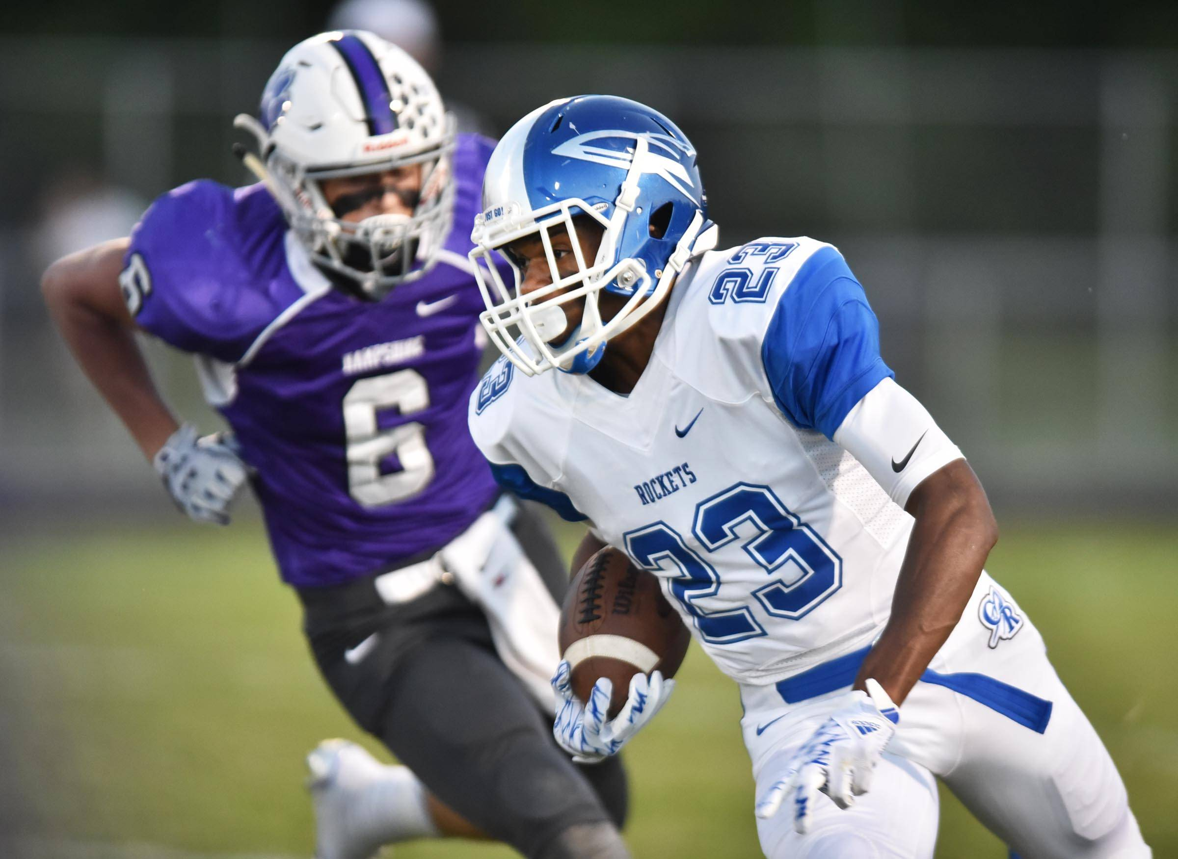 Burlington Central's Dionte Smith is chased by Hampshire's Devin Baldridge Friday in Hampshire.