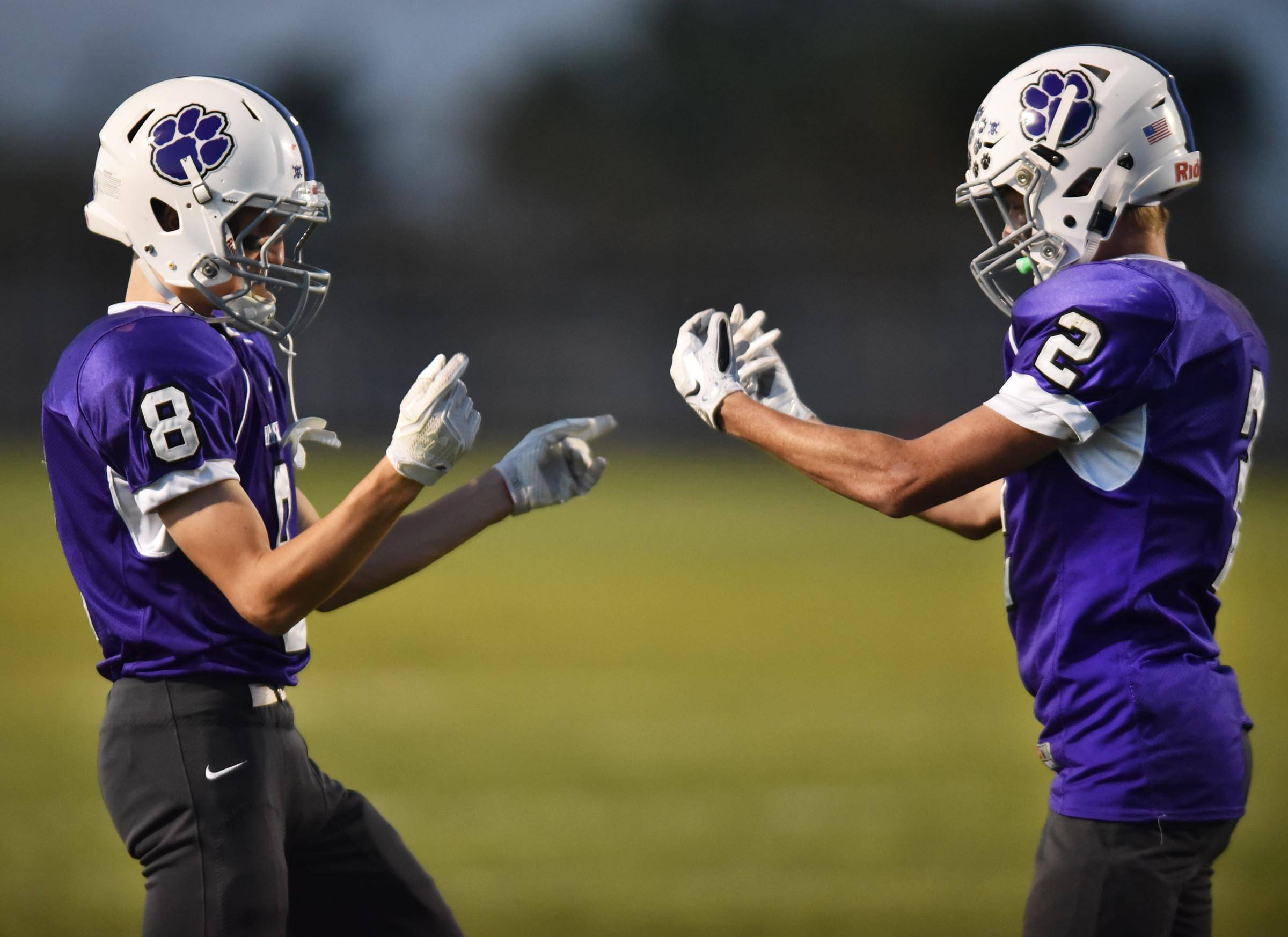 Hampshire's Cameron Fleury celebrates his touchdown catch against Burlington Central with teammate Nicolas Rummell, left, early in the game Friday in Hampshire.
