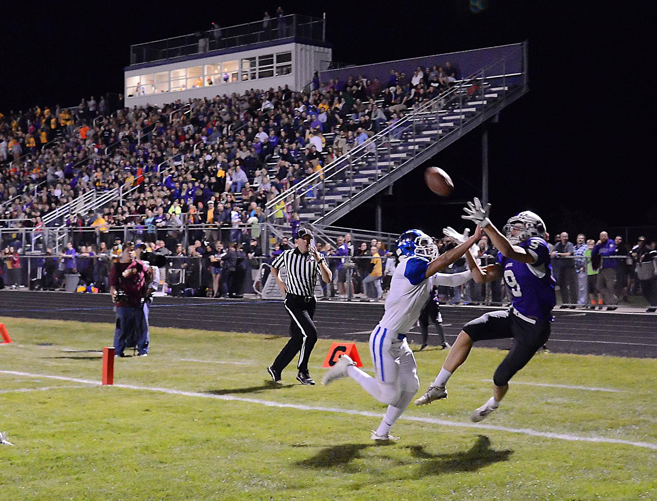Burlington Central's Abraham Alvarez commits pass interference against Hampshire's Erik Starrenburg in the corner of the end zone late in the first half Friday in Hampshire.