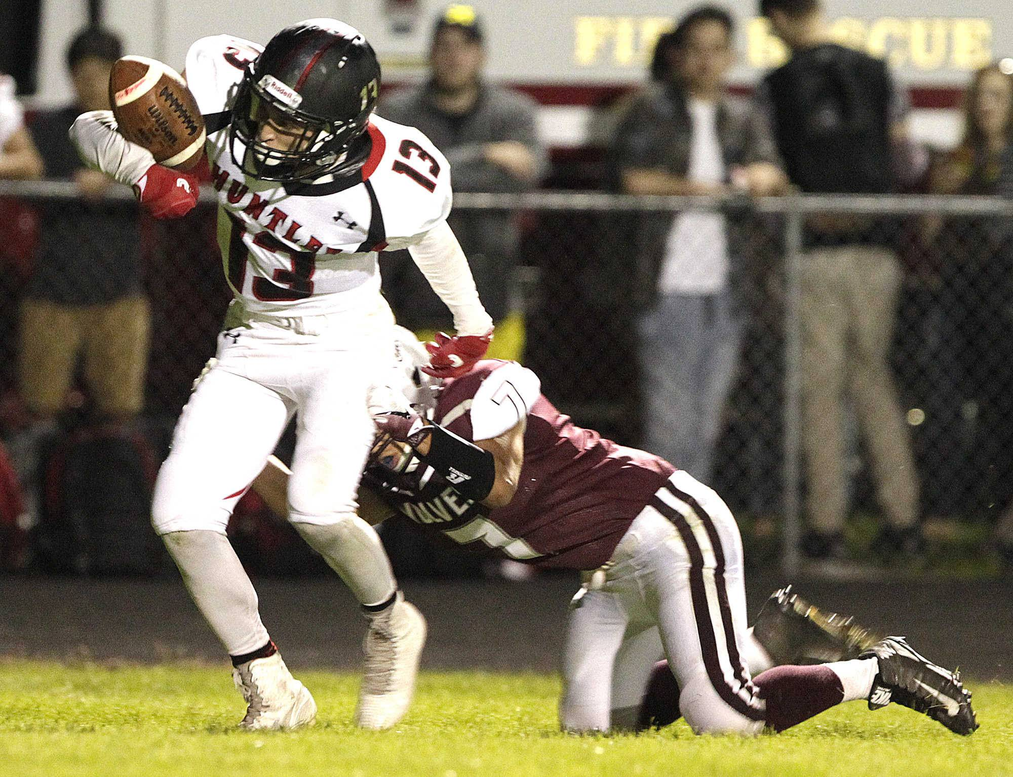 Huntley's Alec Coss cannot hang onto the ball as Prairie Ridge's Daniel Reteria makes the tackle in the first half on Friday.